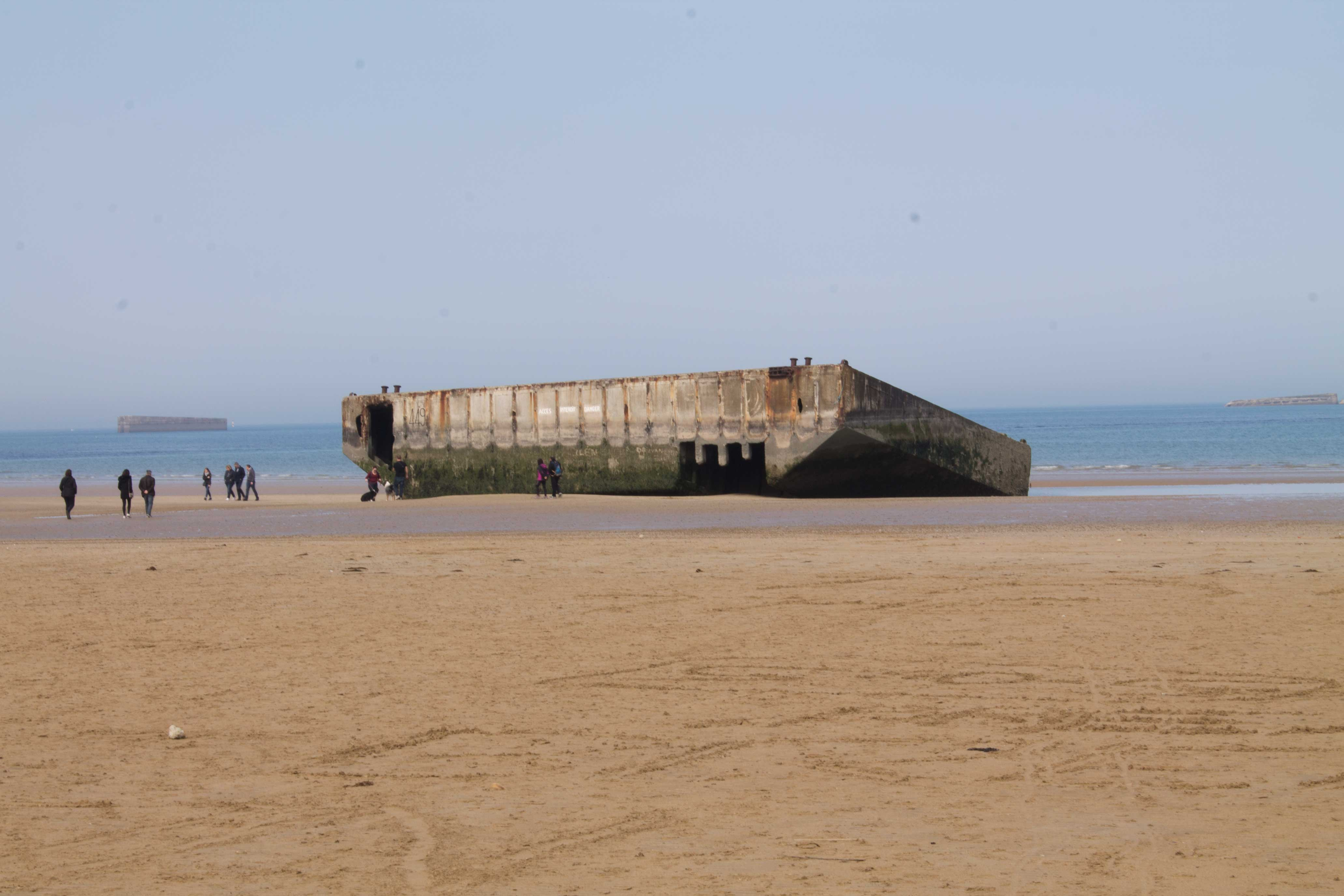 A piece of the British Mulberry harbour washed up on the beach at Arromanches-les-Baines (Jonjo Maudsley/PA)
