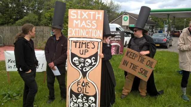 Extinction Rebellion Scotland protesters outside a BP petrol station in Fort William