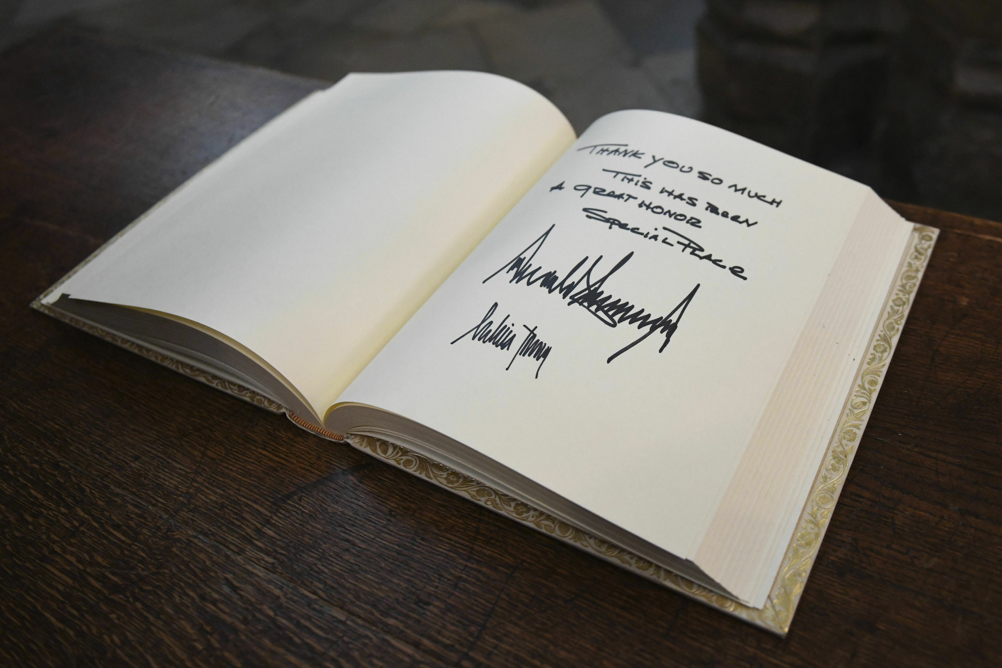 The visitors books signed by US President Donald Trump and his wife Melania