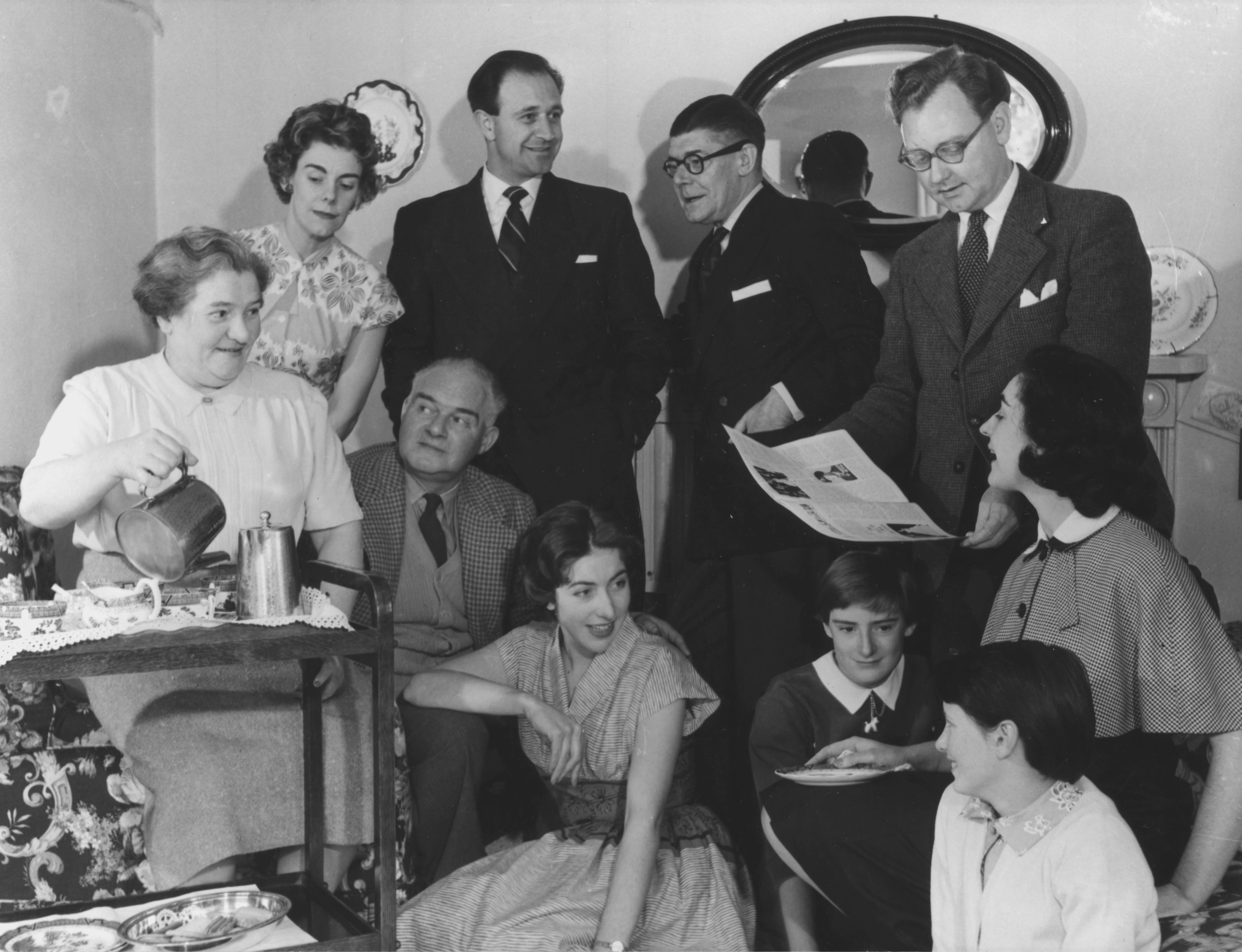 The Archers in 1958, Back row, l-r: Peggy Archer (June Spencer), Paul Johnson (Leslie Dunn), Jack Archer (Denis Folwell), Philip Archer (Norman Painting) Front row l-r: Mrs (Doris) Archer (Gwen Berryman), Dan Archer (Harry Oakes), Christine Johnson (Lesley Saweard), Jennifer Archer (unidentified actress), Lillian Archer (unidentified actress), Jill Archer (Patricia Greene)
