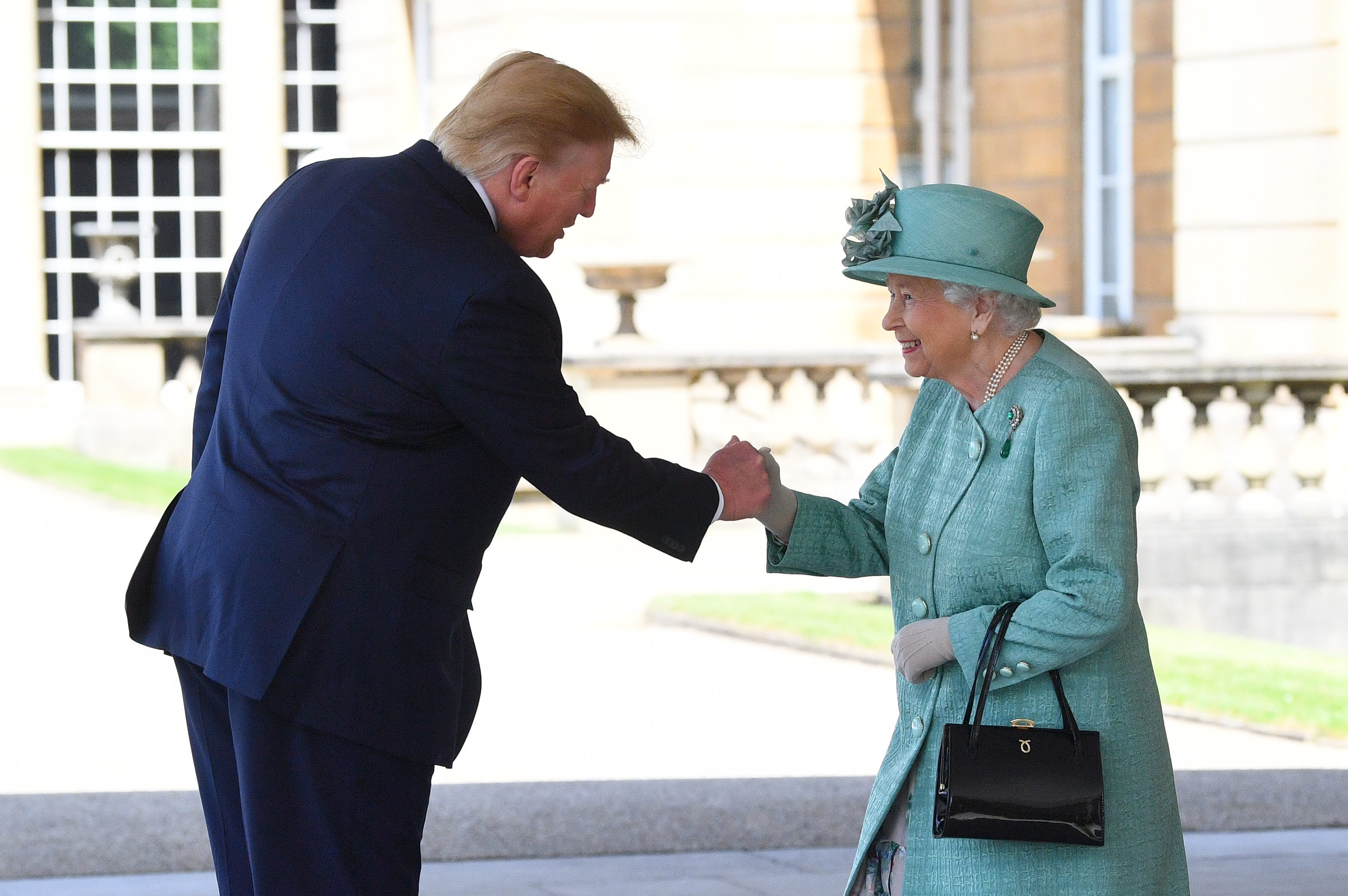 Mr Trump shakes hands with the Queen