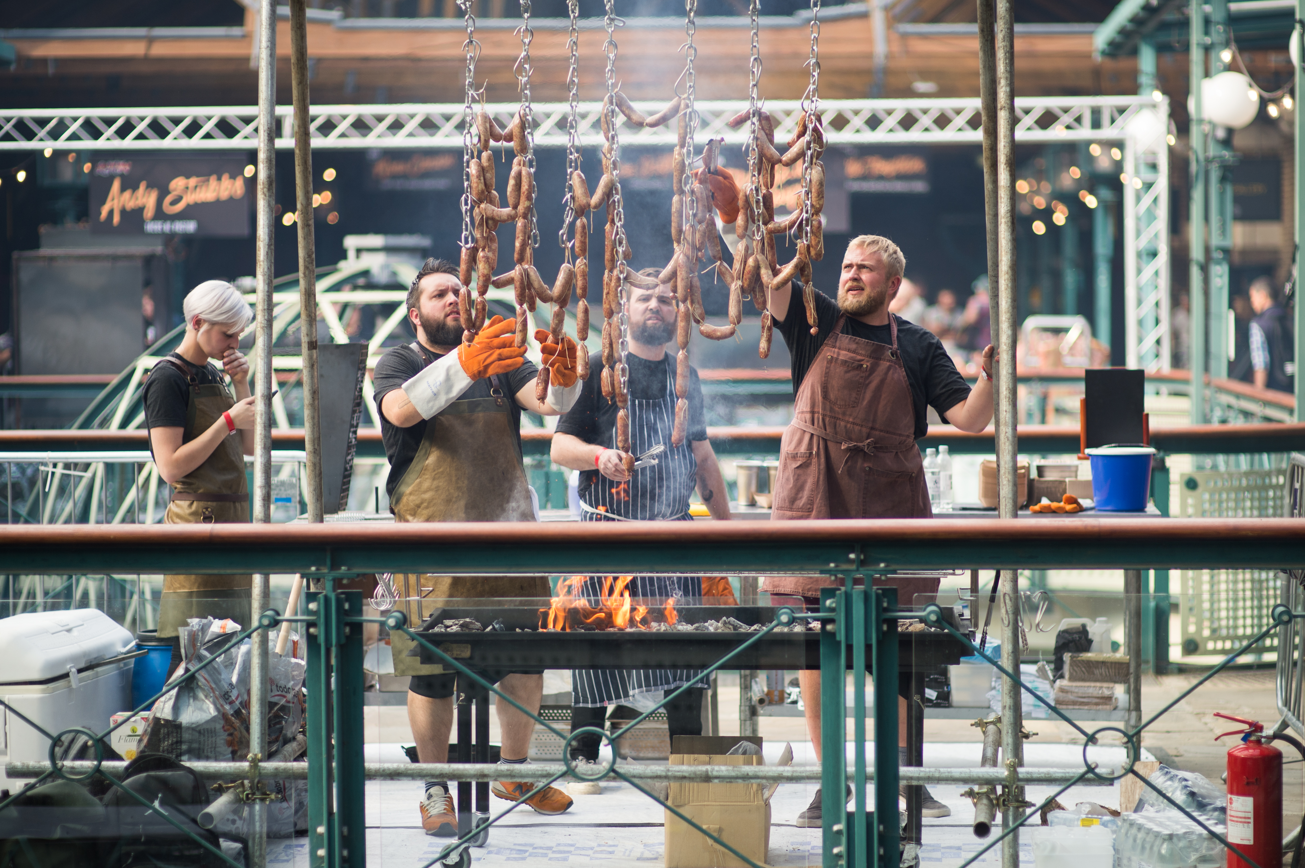 Chefs hanging meat at Meatopia (Meatopia/PA)