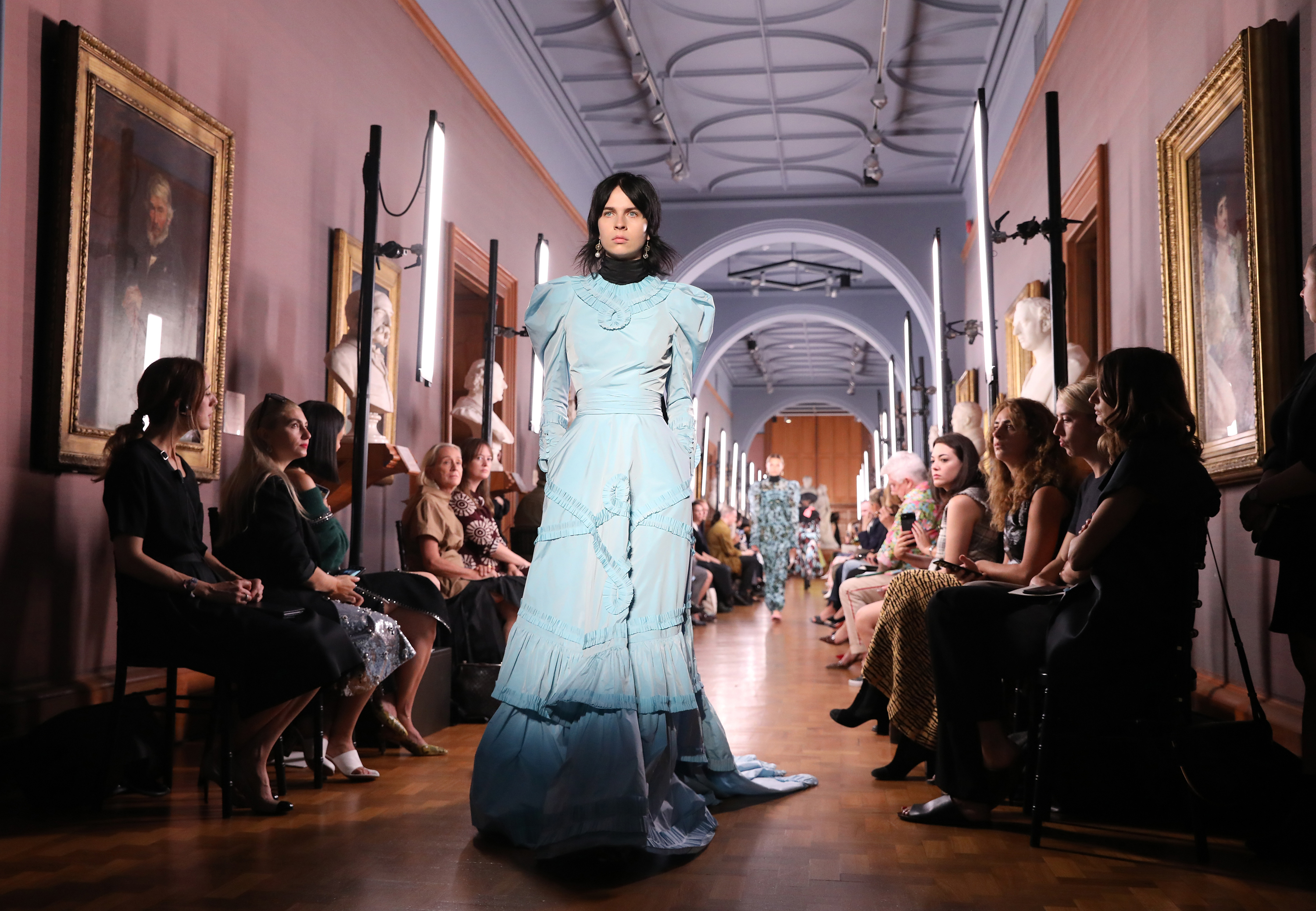 Models on the catwalk during the Erdem London Fashion Week September 2018 show at The National Portrait Gallery in London.