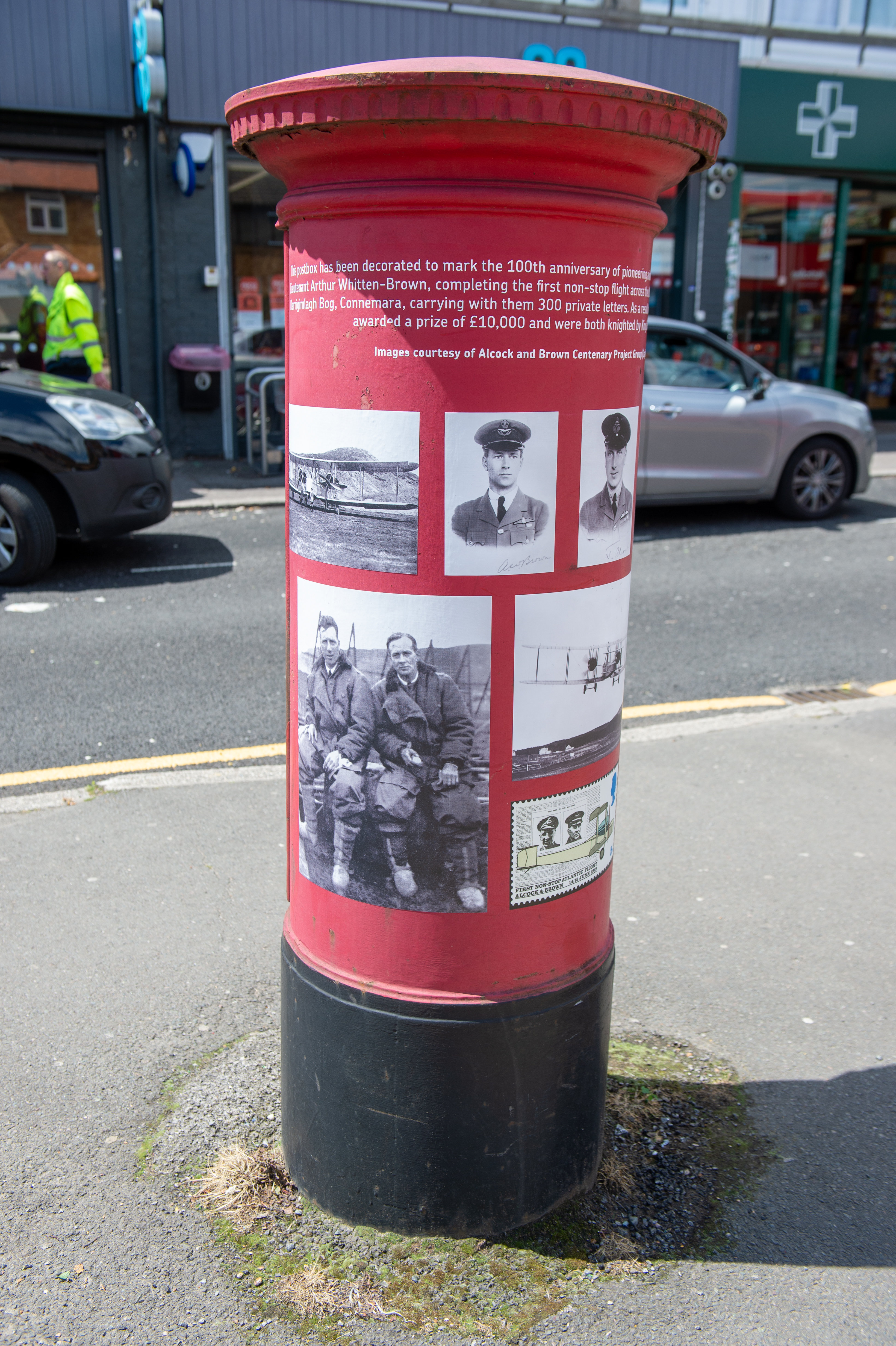 A postbox on Harlington High Street that has been decorated to commemorate 100 years of pioneering aviators Captain John Alcock and Lieutenant Arthur Whitten Brown