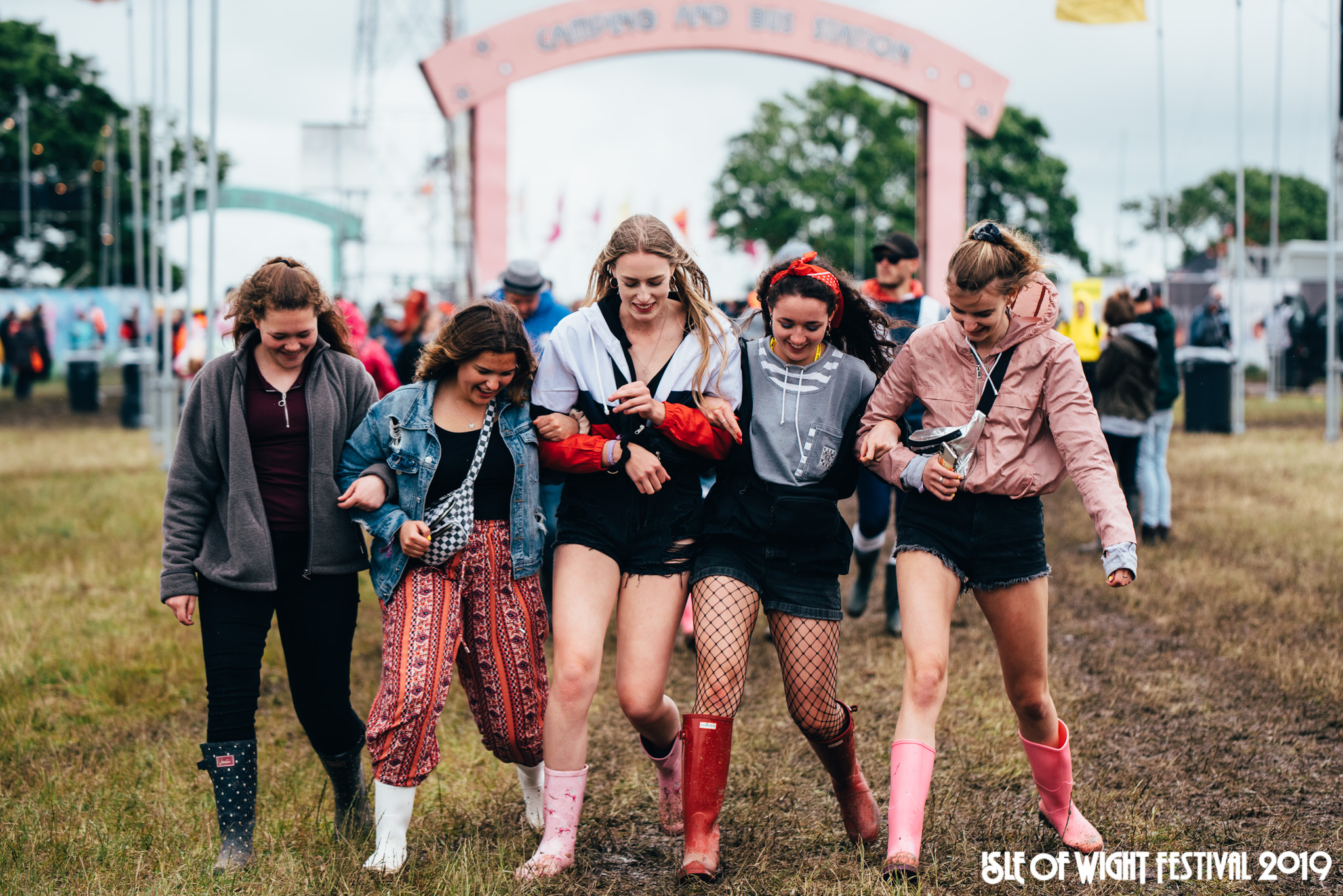 Festival-goers braving the mud on Thursday