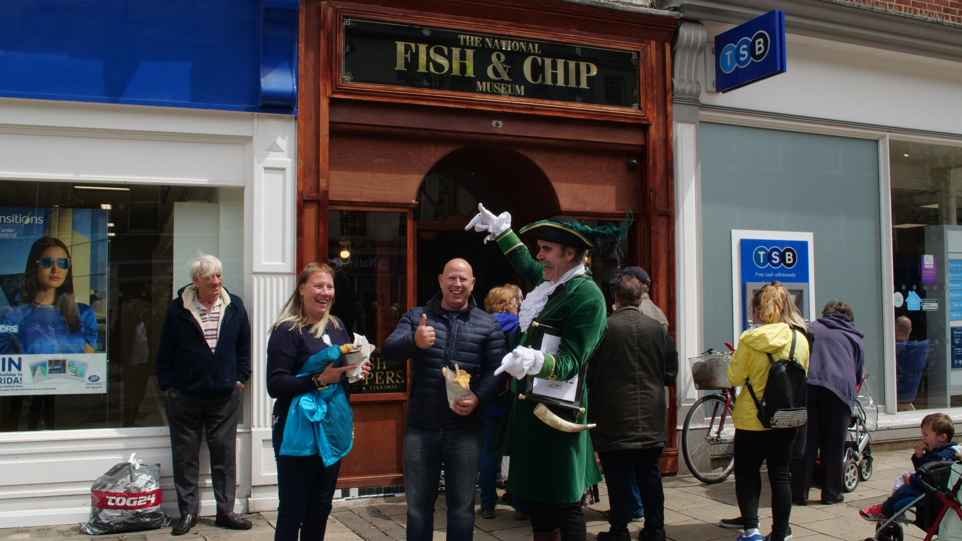 Customers pose with their fish and chips in York outside the National Fish & Chip Museum