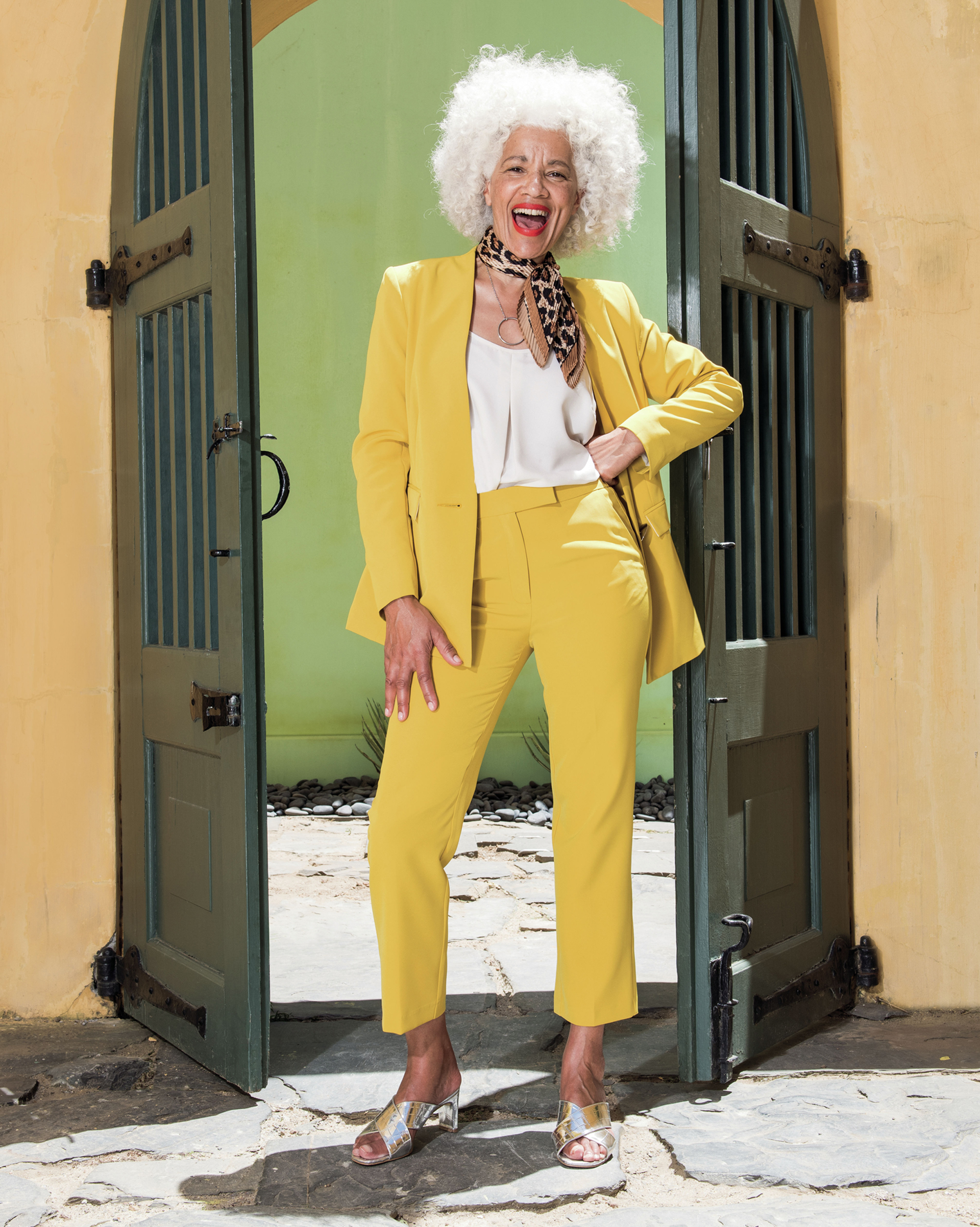 JD Williams Statement Collarless Blazer, £49.50 (was £55); Warm Ivory Strappy Cami Top; Statement Yellow Tapered Leg Trousers; Square Heel Crossover Mule Sandals