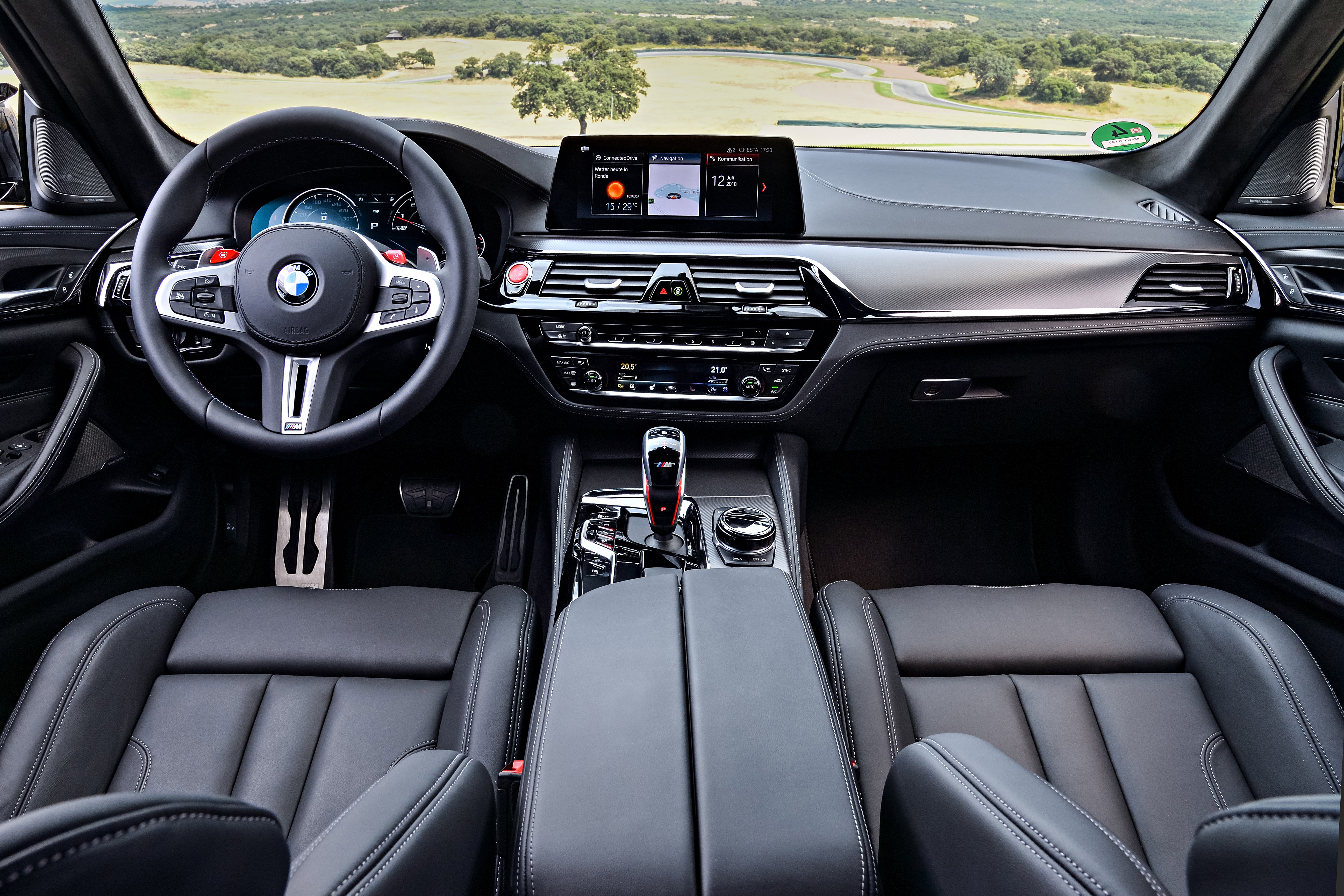The interior remains largely unchanged over the standard M5