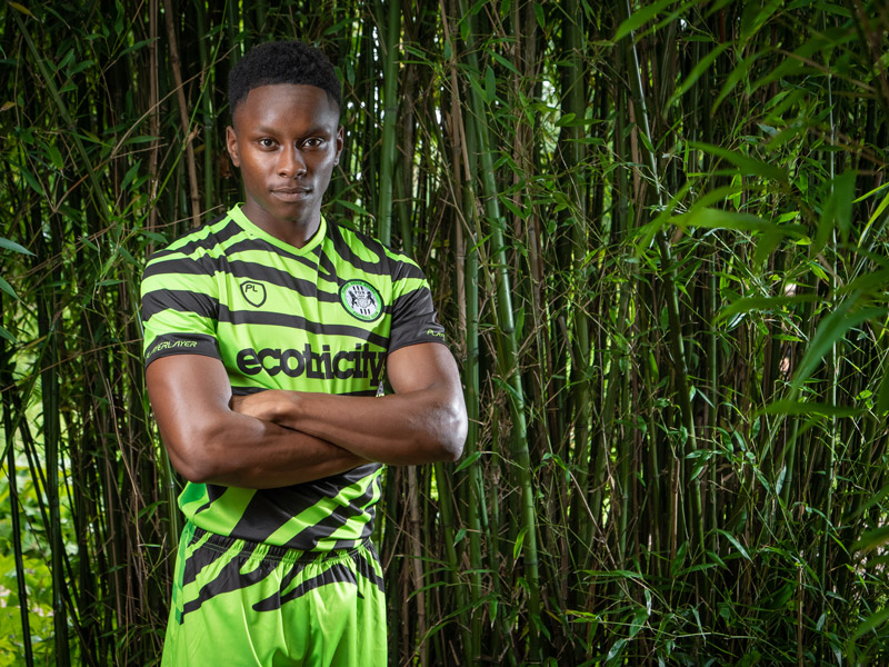 Green zebra-patterned football kit