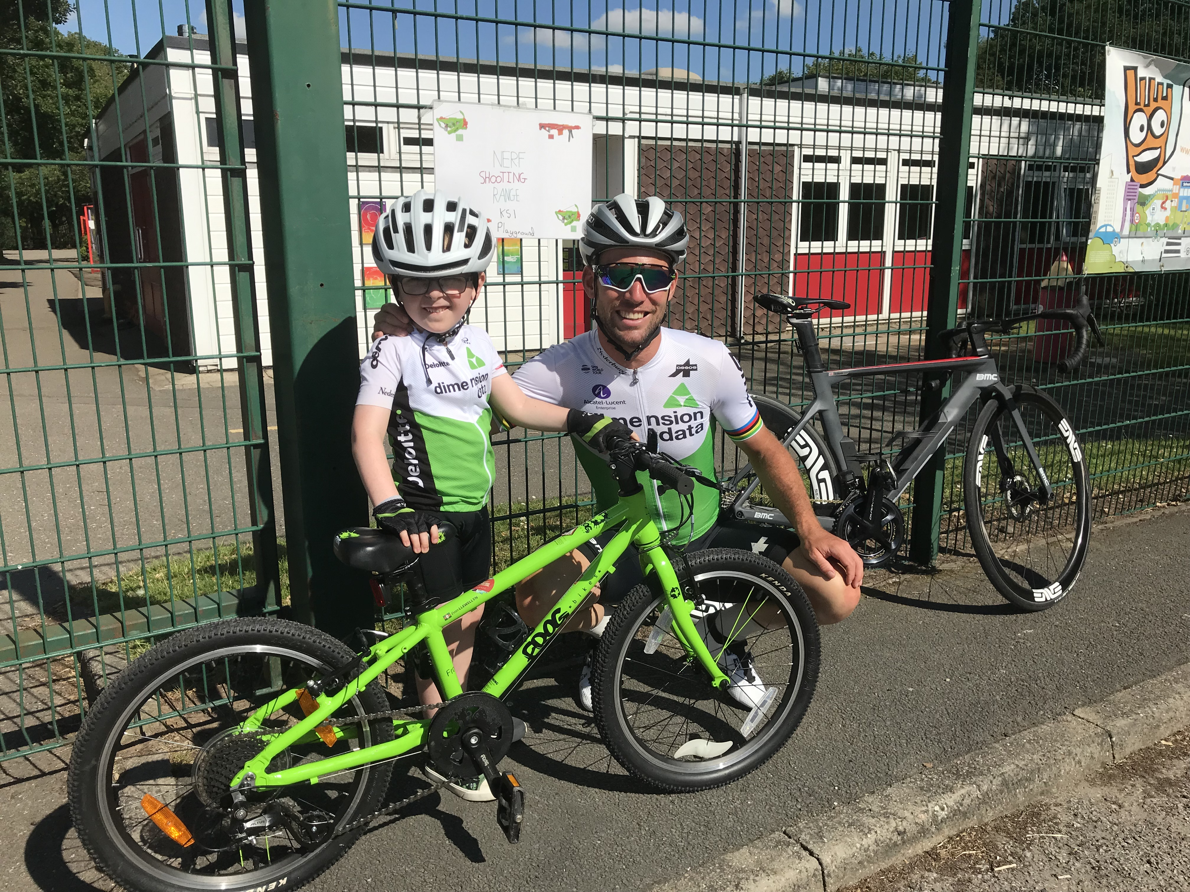 Mark Cavendish poses for a photo with cycling fan Evan Llewellyn