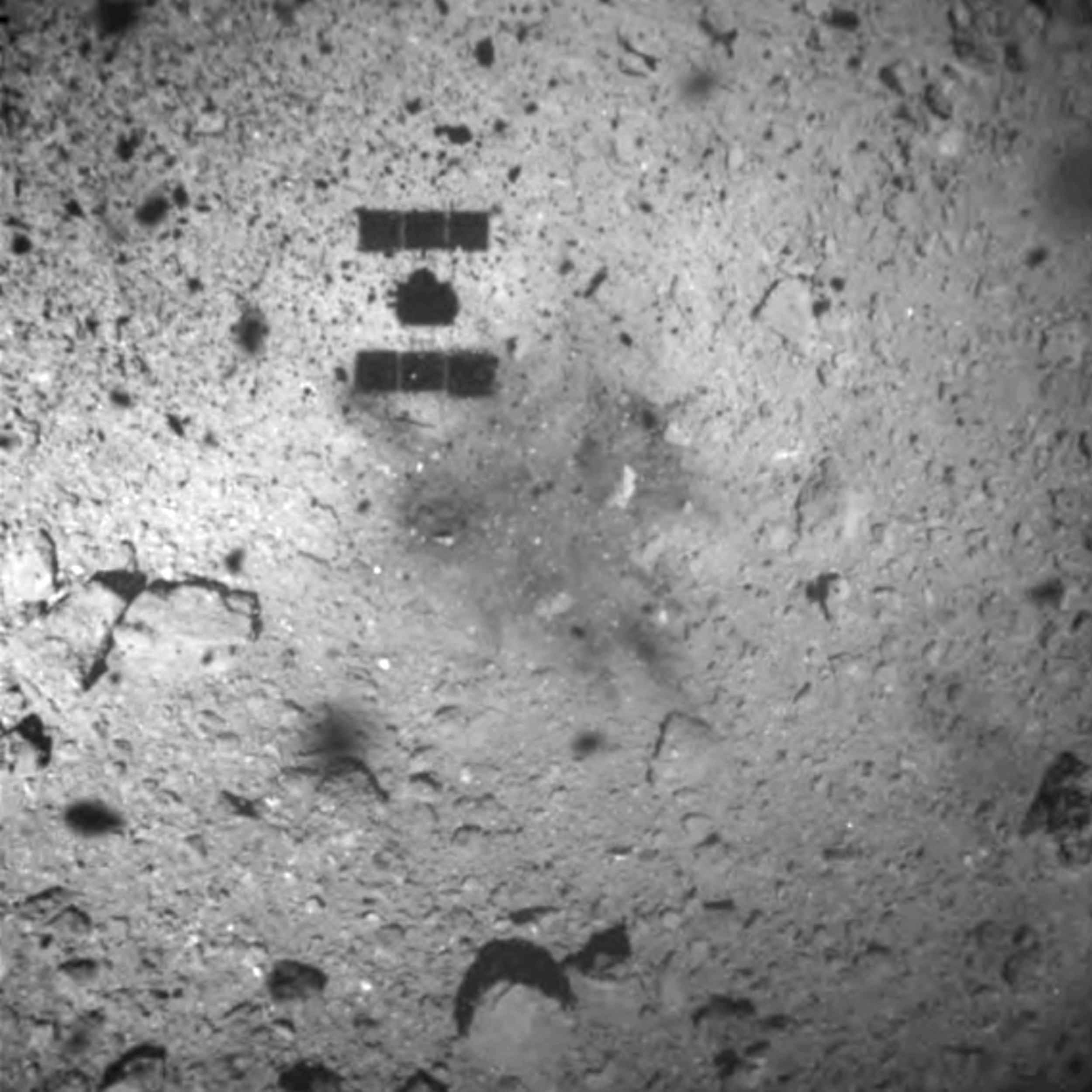 The shadow, centre above, of the Hayabusa2 spacecraft after its successful touchdown on the asteroid Ryugu