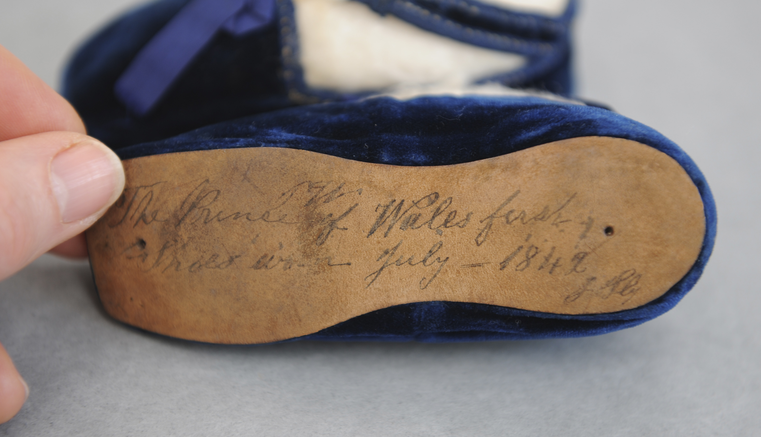 The inscription on the shoes