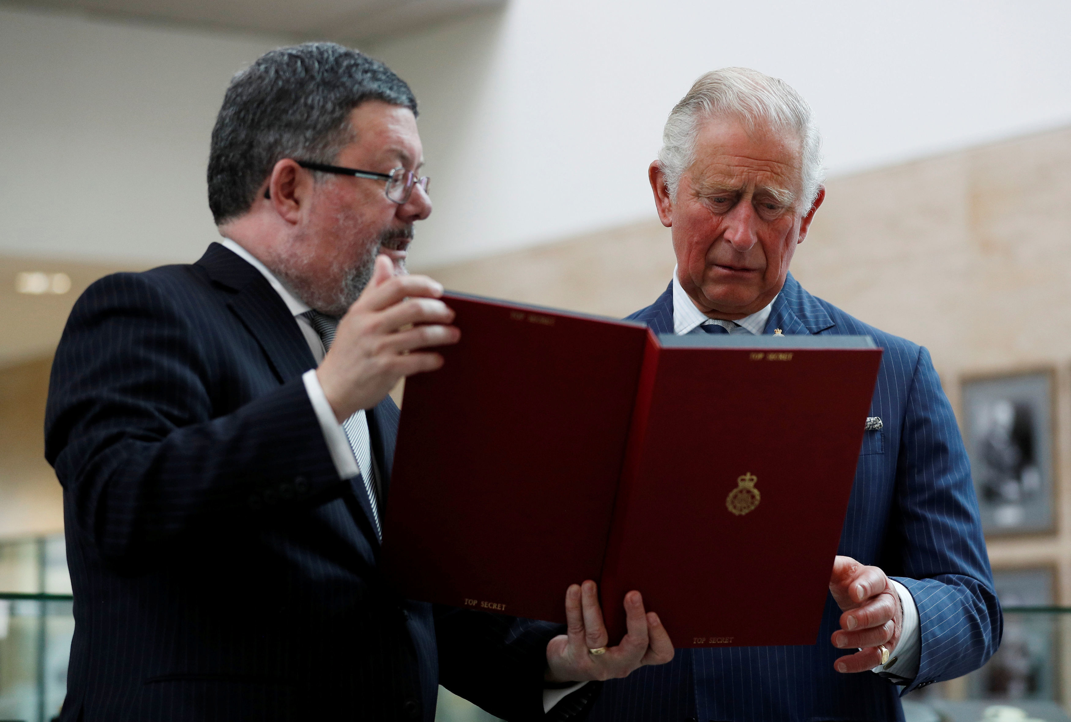 The Prince of Wales, as Patron of the Intelligence Agencies, talks with the GCHQ historian Tony Comer
