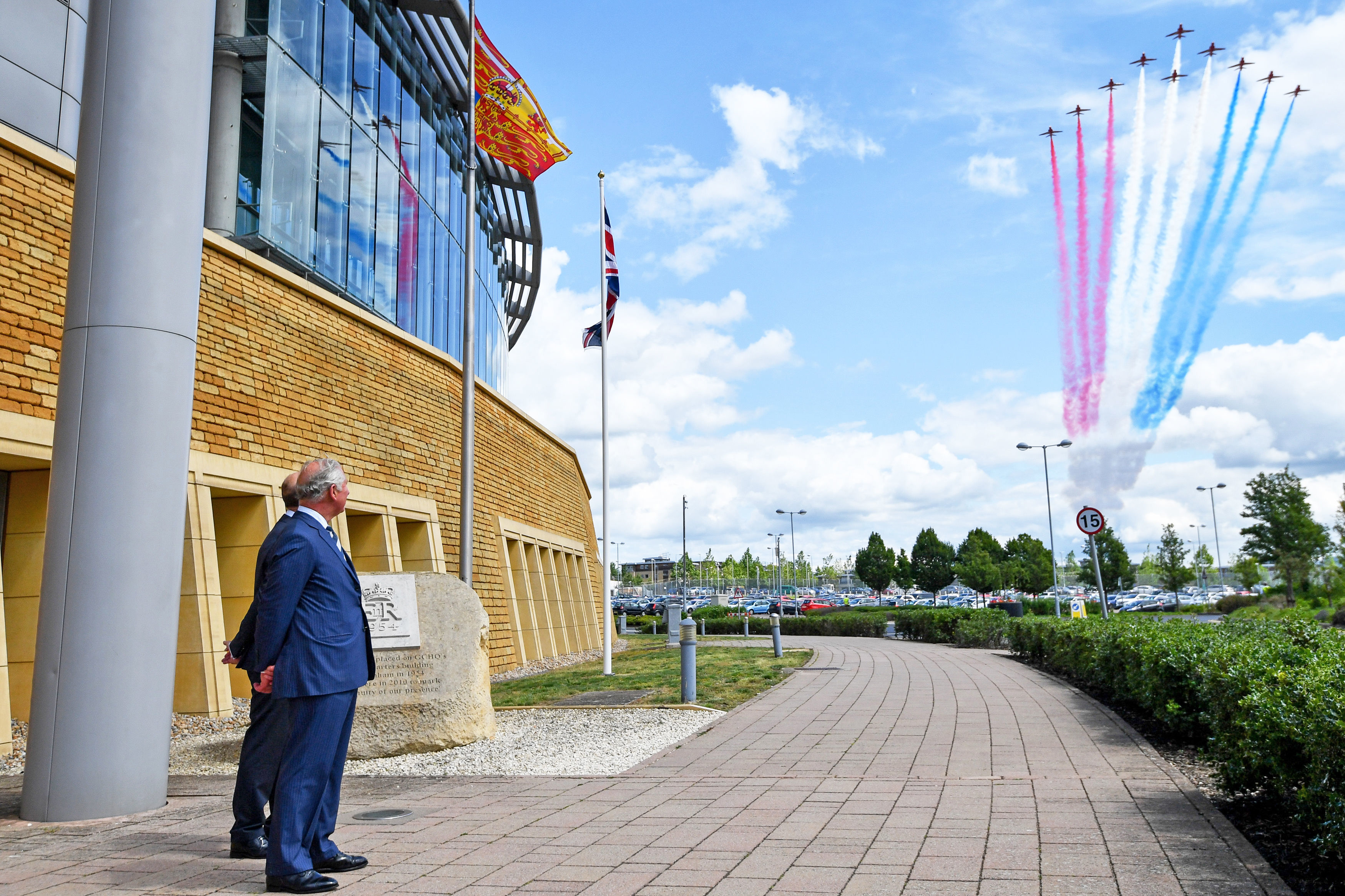 Charles watches a Red Arrows flypast during a visit to the Government Communications Headquarters
