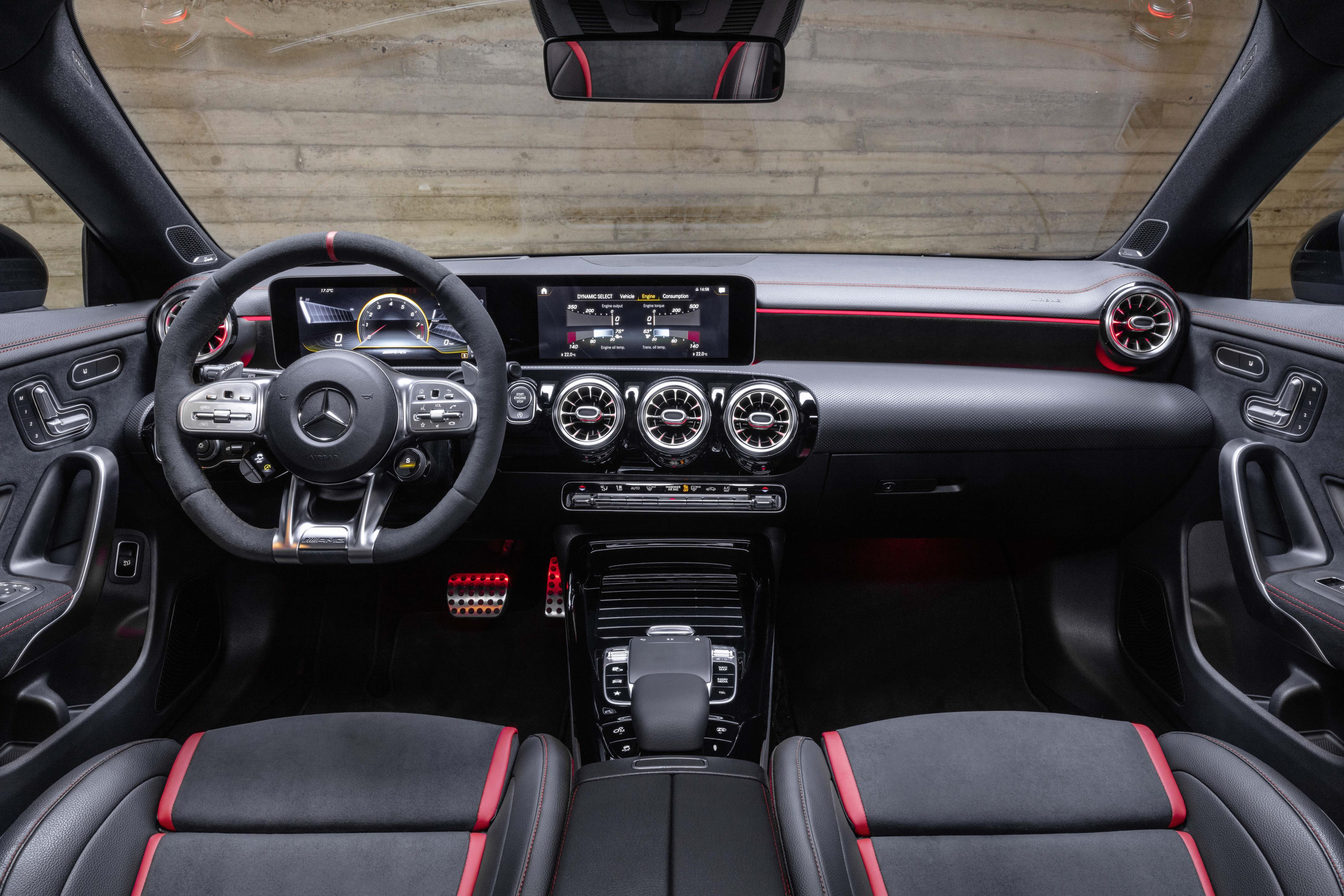 The interior of the CLA features sports seats and a matching steering wheel