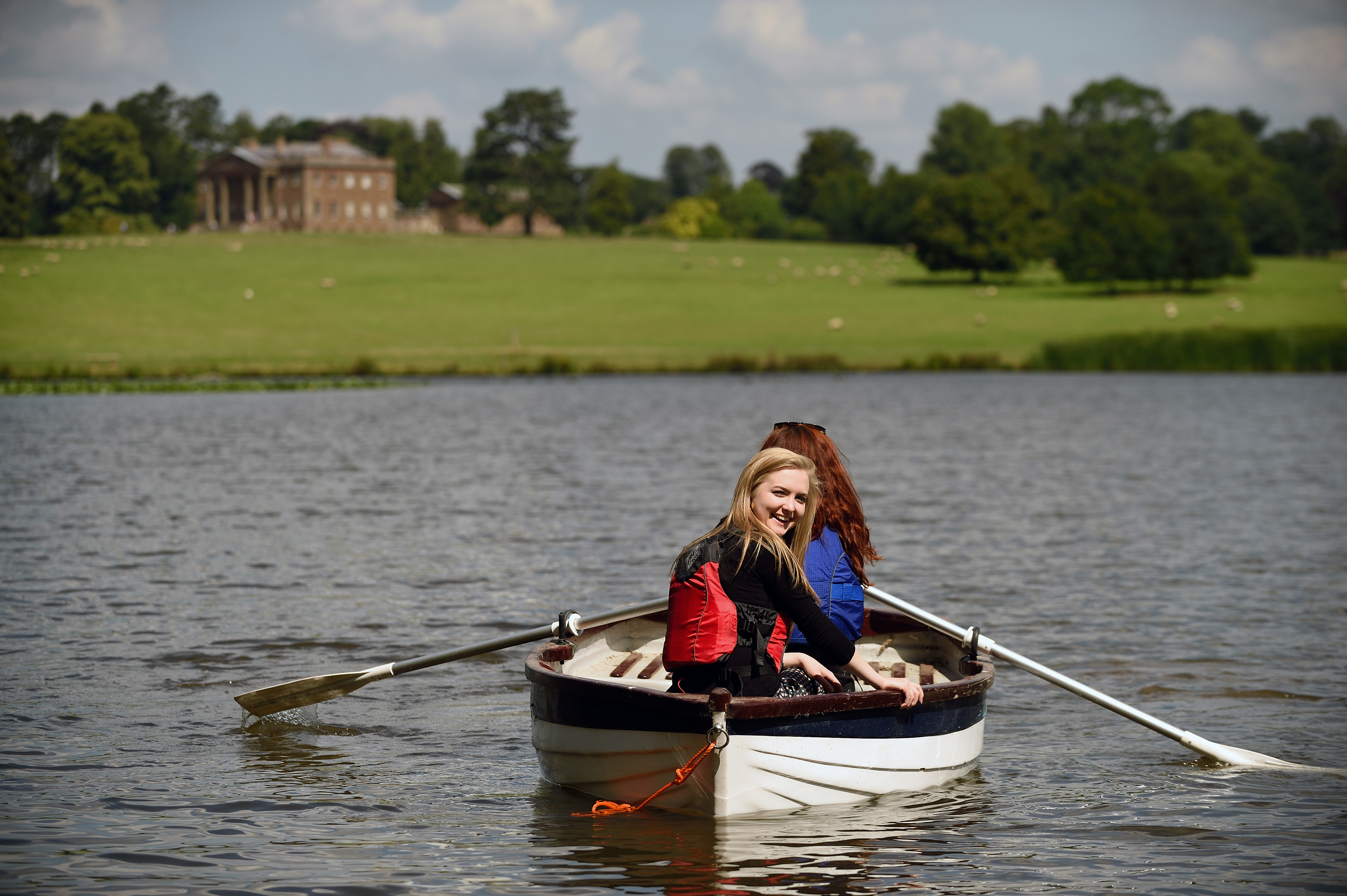 Visitors take to the water on Berrington Pool (John Millar/National Trust Images/PA)