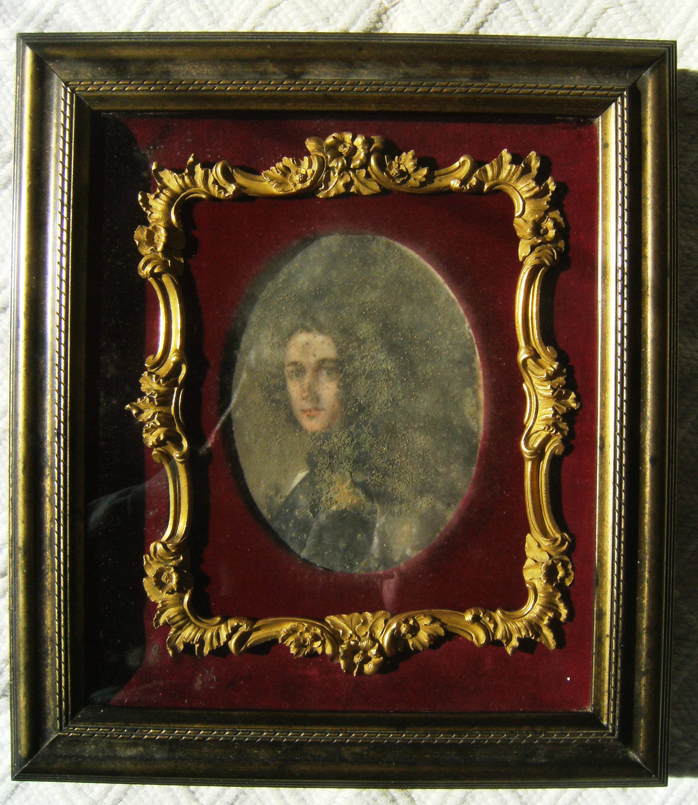 The portrait when it was covered in mould