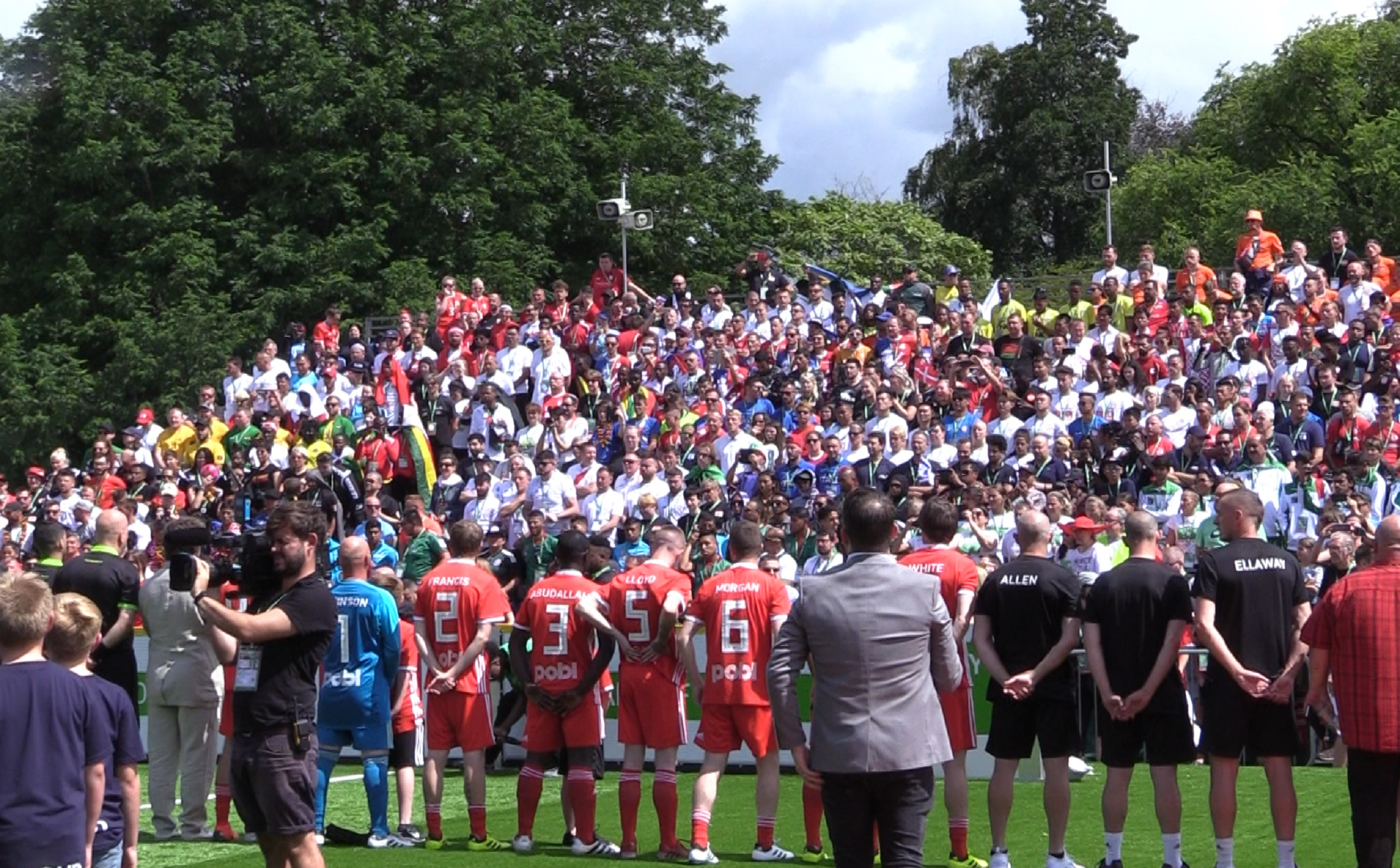 Wales and Denmark line up for the national anthems ahead of the opening men's game at the Homeless World Cup