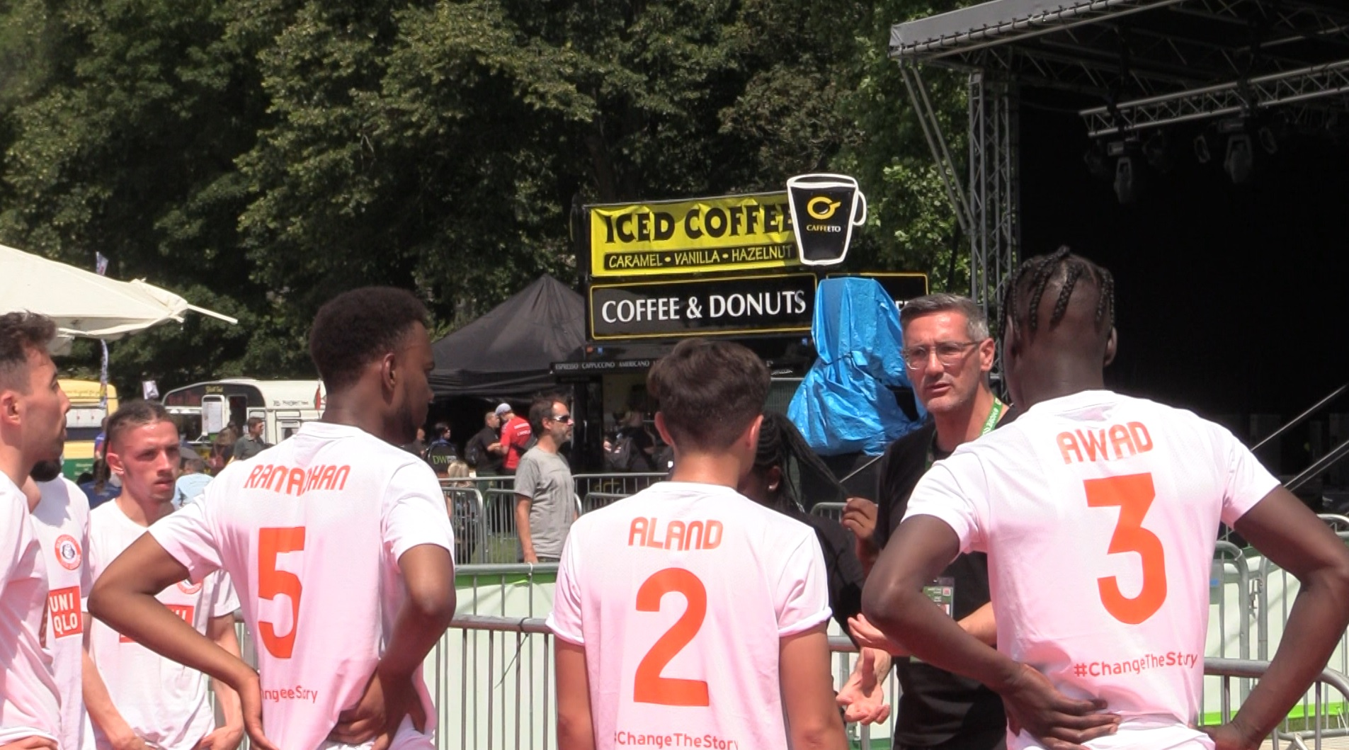 Craig McManus, manager of the England men's team at the 2019 Homeless World Cup, talks to his players