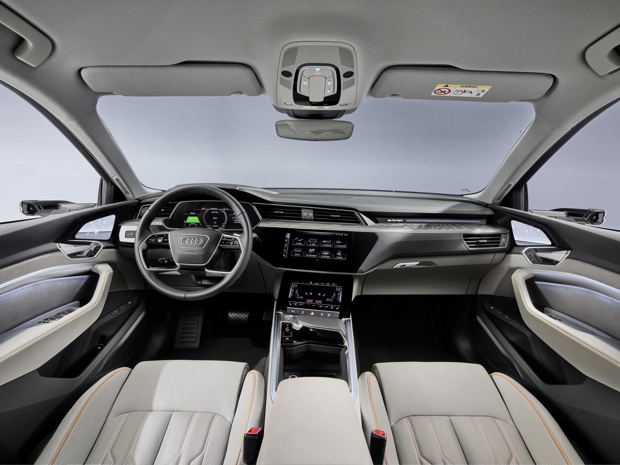 The interior of the car features dual touchscreens
