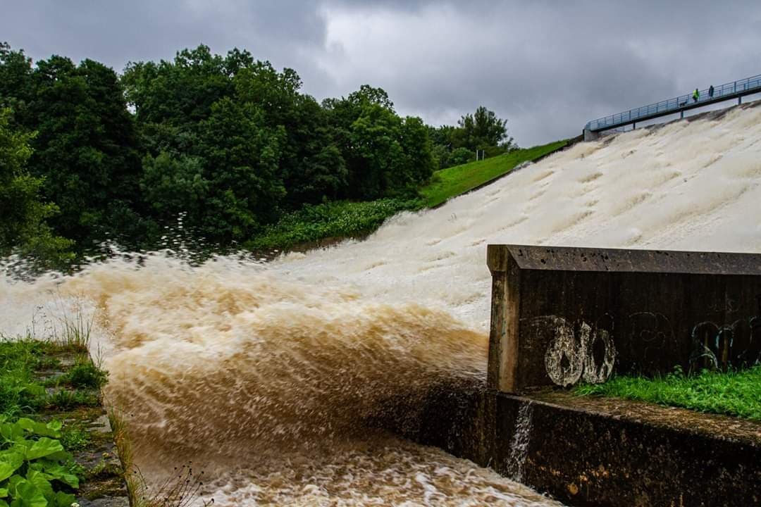 Water cascading down the dam on Wednesday
