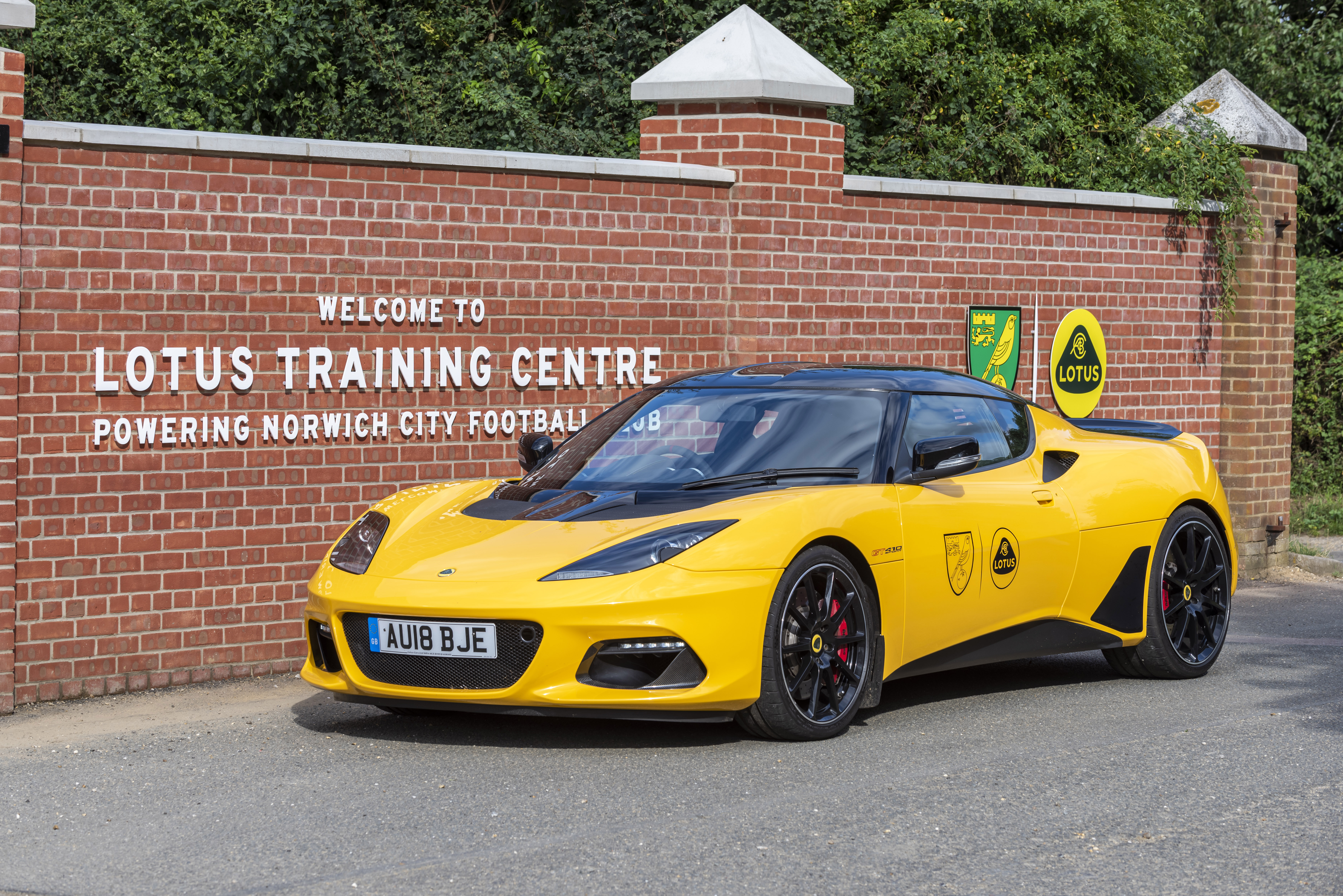 image of a Lotus parked outside the newly named training centre in conjunction with Lotus reveals rebrand