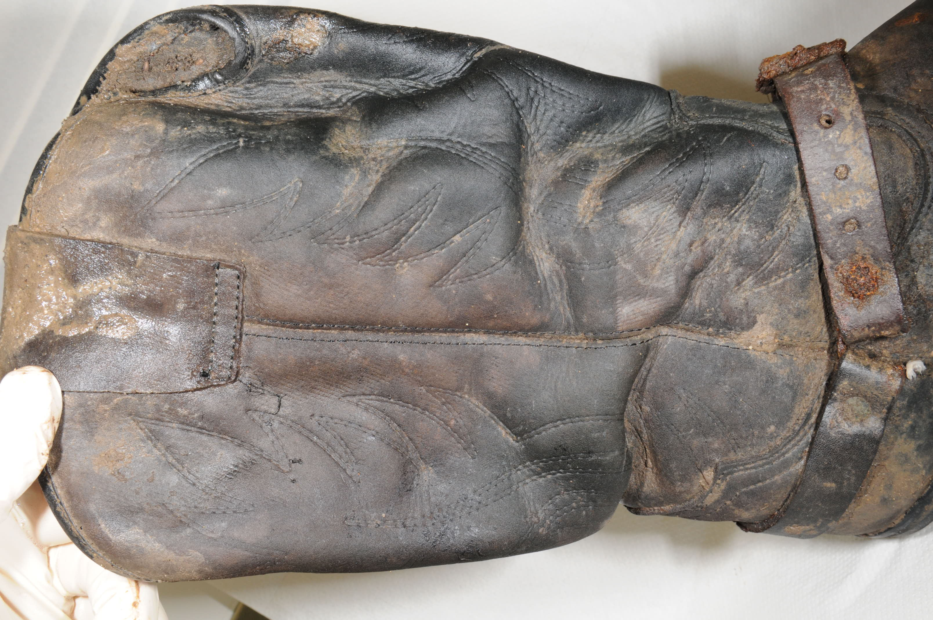 Essex Police has issued photographs of a 'distinctive pair of leather cowboy-style boots' found alongside the skeleton of a man at a scrapyard in St Osyth. (Essex Police/ PA)