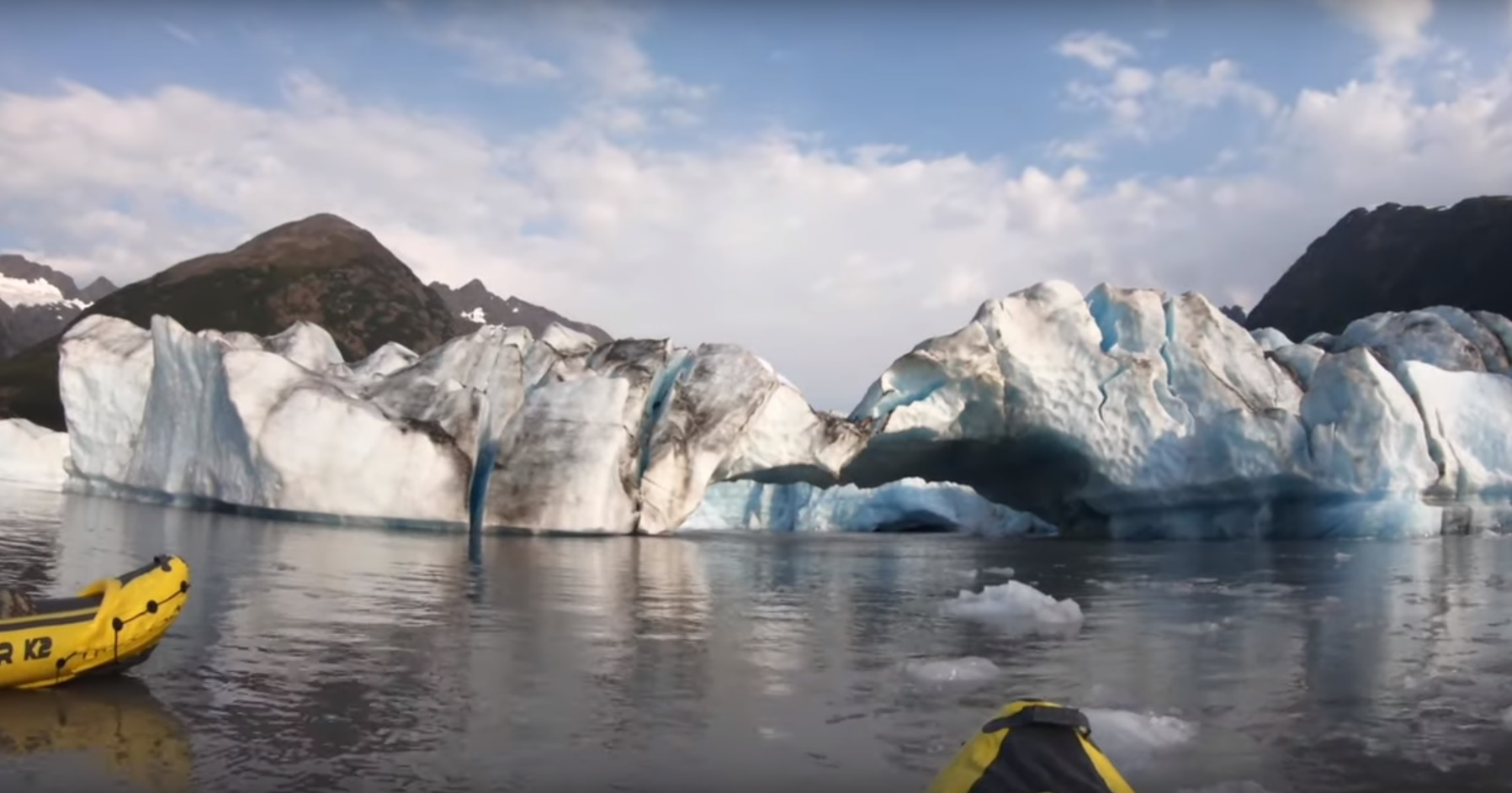 A glacier in Alaska as seen by two kayakers