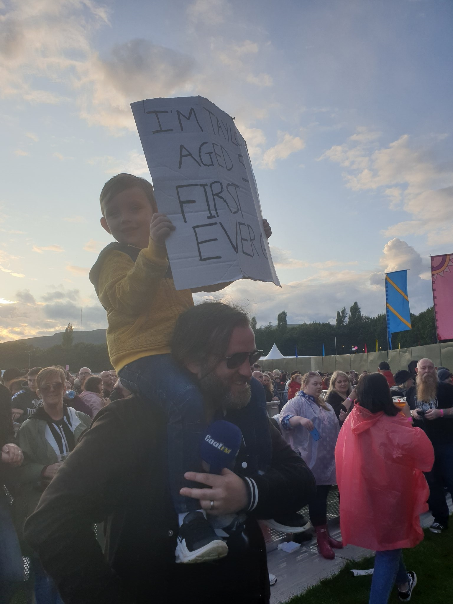 Taylor Blackburn, 5, holds a sign up that reads 'I'm Taylor Aged 5 First Ever Gig'