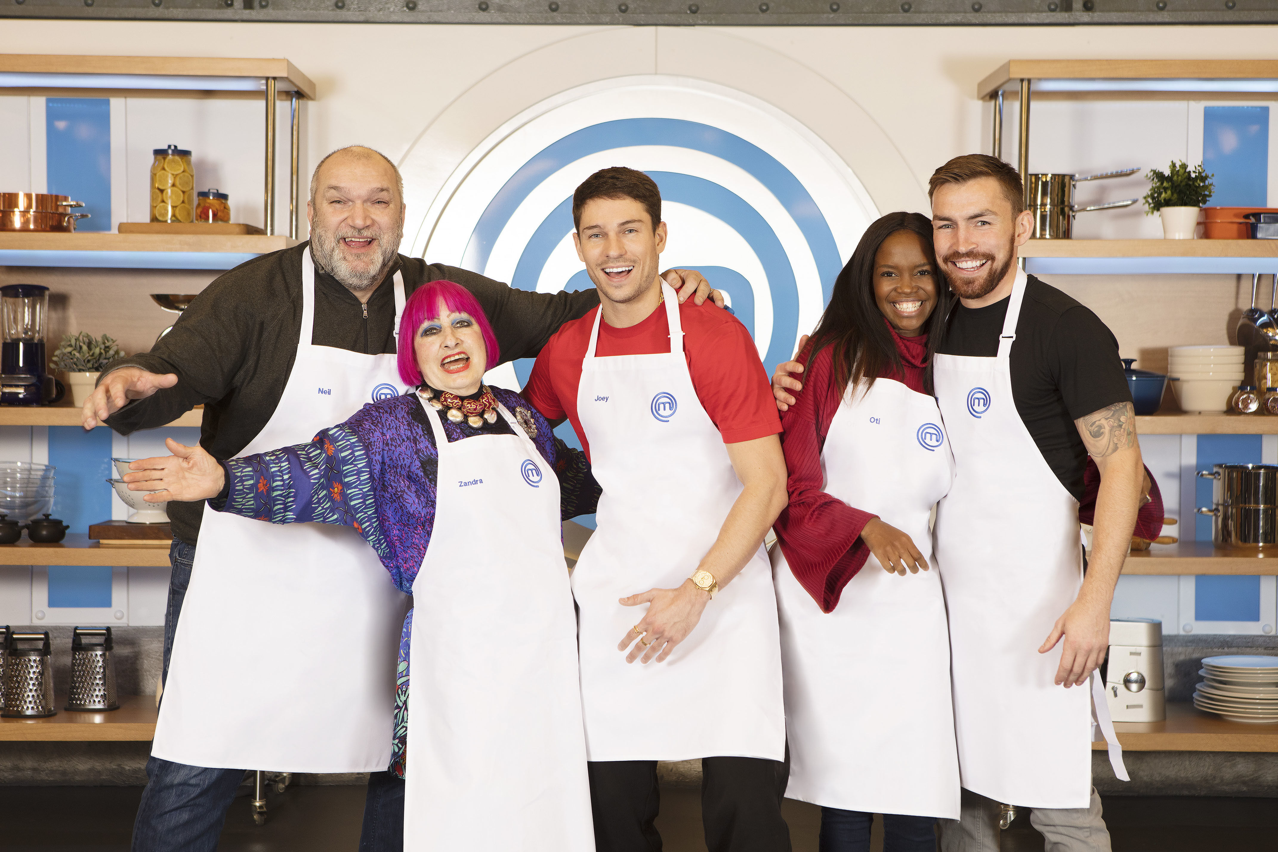 Undated BBC Handout Photo from Celebrity Masterchef. Pictured: (L-R) Neil Ruddock, Zandra Rhodes, Joey Essex, Oti Mabuse and Andy Grant. See PA Feature SHOWBIZ TV Essex. Picture credit should read: PA Photo/BBC/Shine TV. WARNING: This picture must only be used to accompany PA Feature SHOWBIZ TV Essex. WARNING: Use of this copyright image is subject to the terms of use of BBC Pictures' BBC Digital Picture Service. In particular, this image may only be published in print for editorial use during the publicity period (the weeks immediately leading up to and including the transmission week of the relevant programme or event and three review weeks following) for the purpose of publicising the programme, person or service pictured and provided the BBC and the copyright holder in the caption are credited. Any use of this image on the internet and other online communication services will require a separate prior agreement with BBC Pictures. For any other purpose whatsoever, including advertising and commercial prior written approval from the copyright holder will be required.