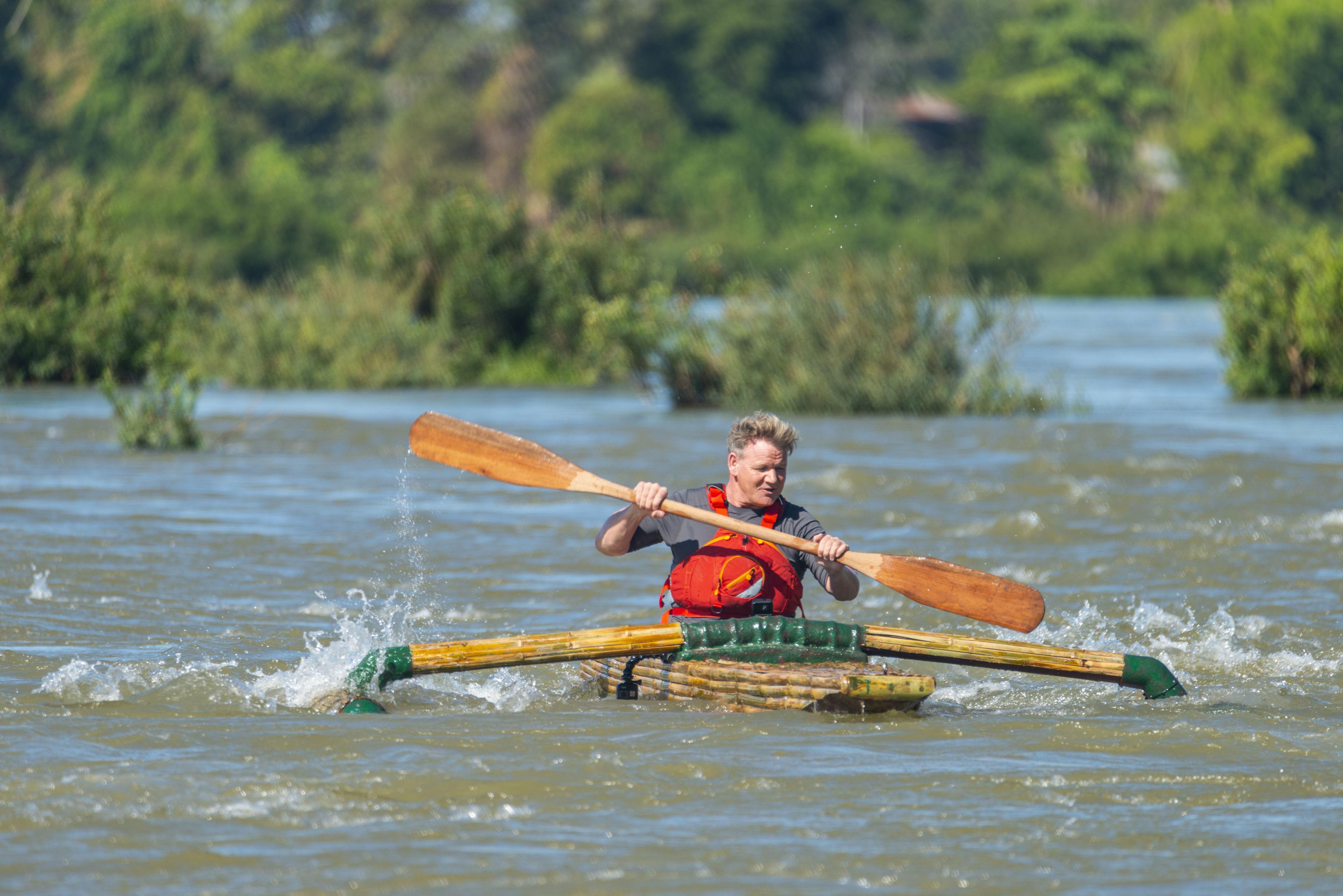 Ramsay making his way down the Mekong River, Laos