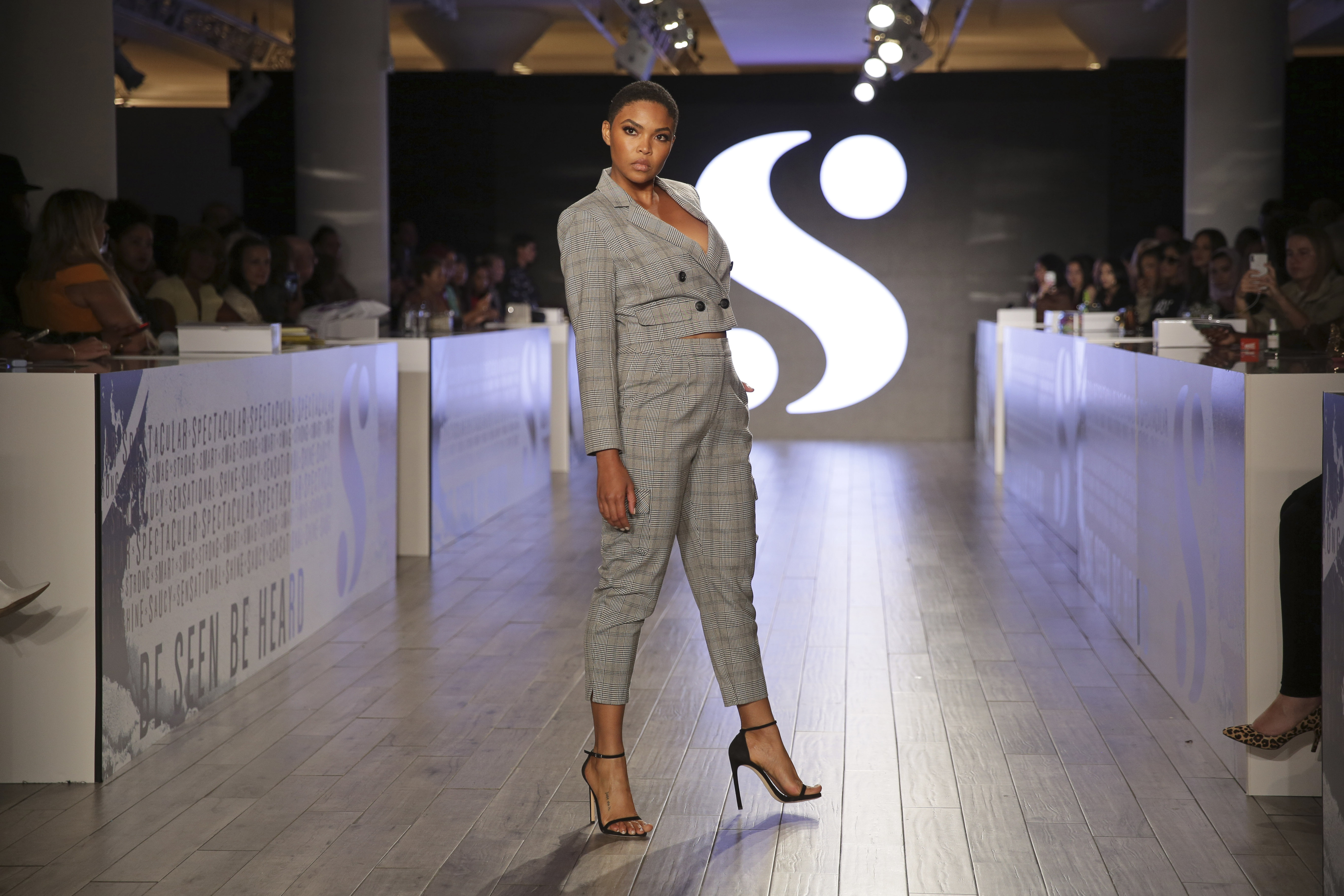 A model wears clothes by Serena Williams during Fashion Week in New York, Tuesday, Sept. 10, 2019