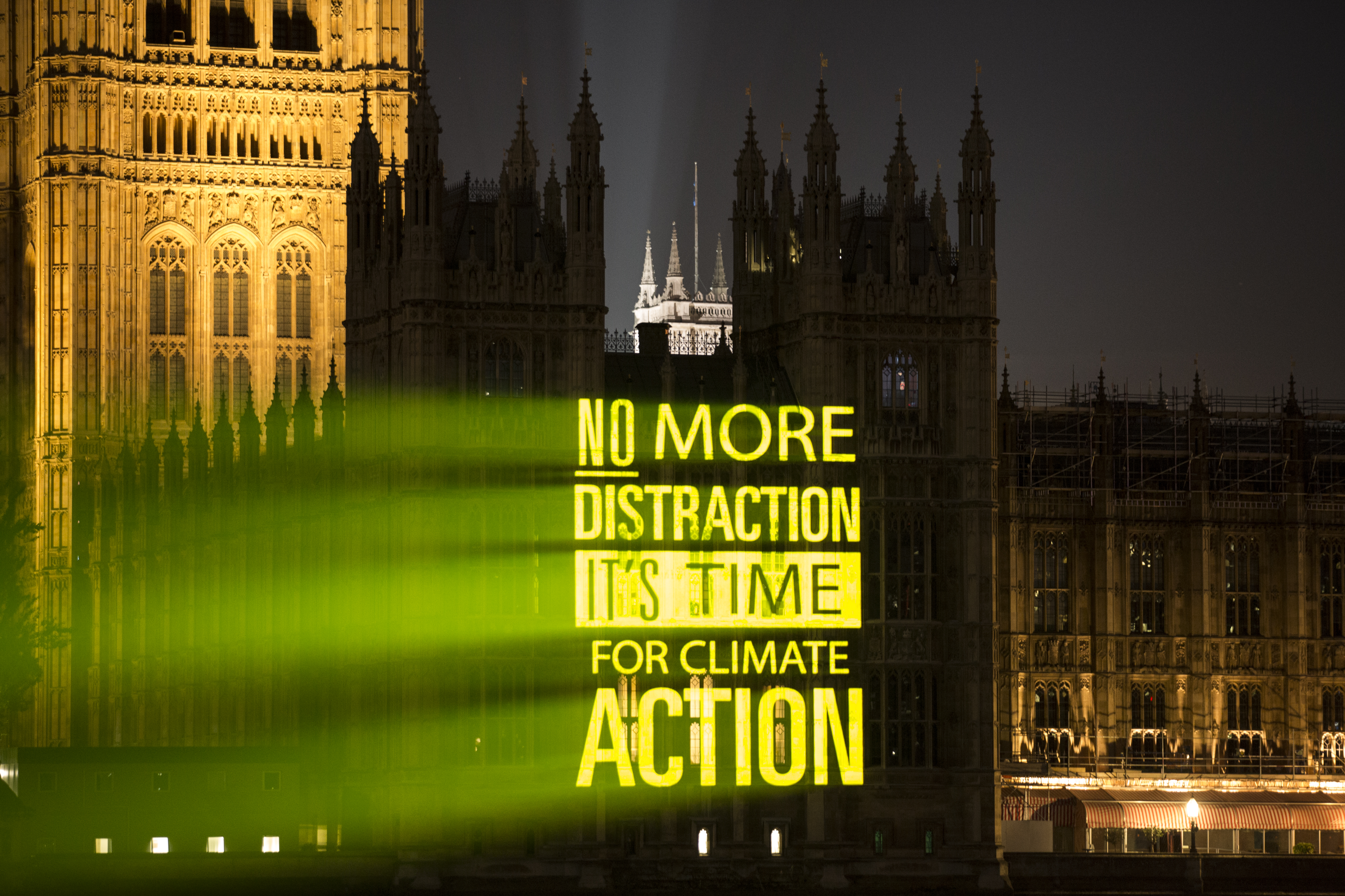 UK Student Climate Network projected messages on landmarks including parliament promoting the strike (Samuel Keyte)