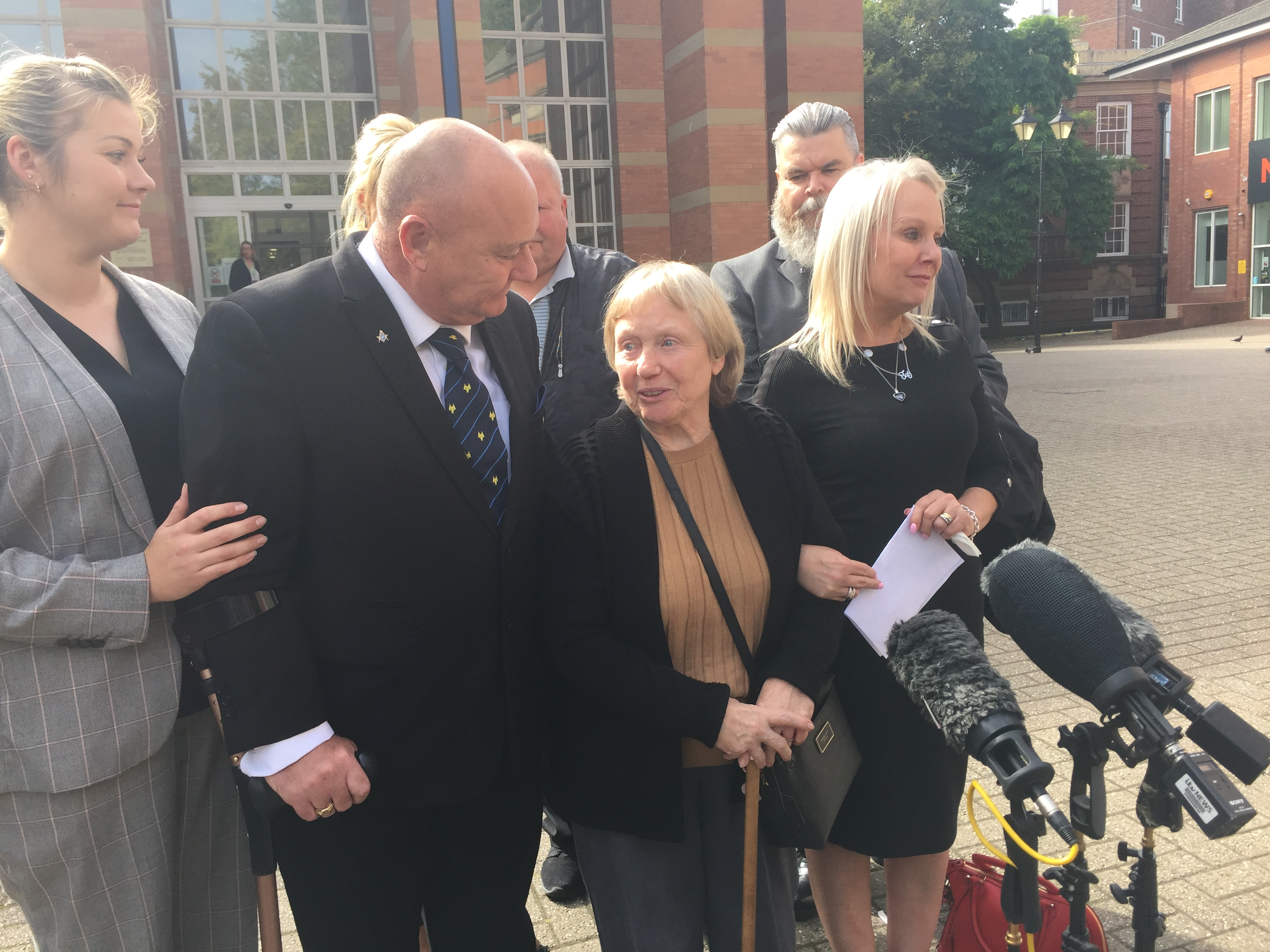 Mavis Eccleston outside Stafford Crown Court after her acquittal, flanked by her daughter Joy and son Kevin
