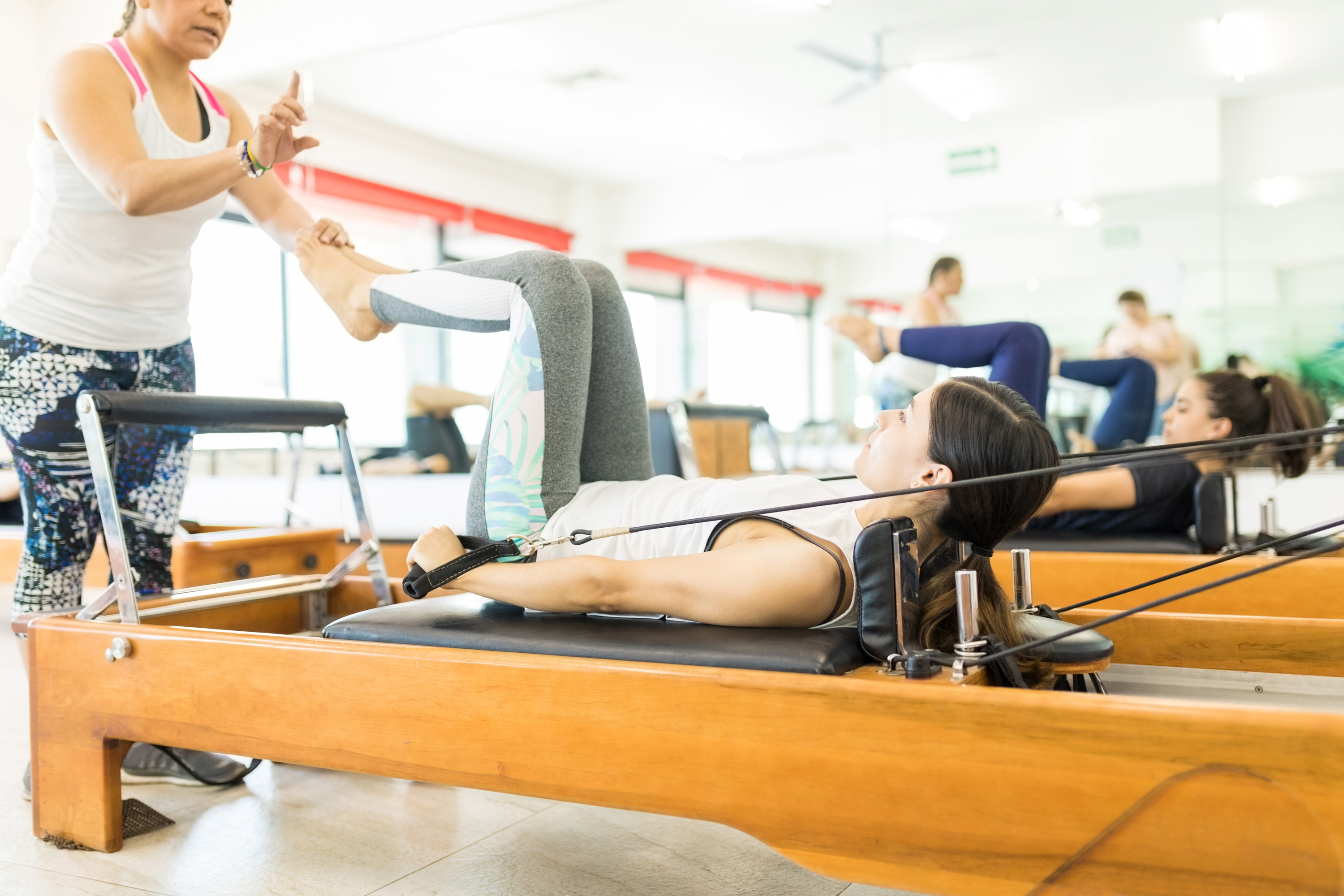 Generic stock image of a pilates instructor showing a woman how to use a reformer machine. See PA Feature WELLBEING Reformer. Picture credit should read: iStock/PA. WARNING: This picture must only be used to accompany PA Feature WELLBEING Reformer.