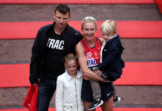 Paula Radcliffe celebrates completing the 2015 Virgin Money London Marathon with her family.