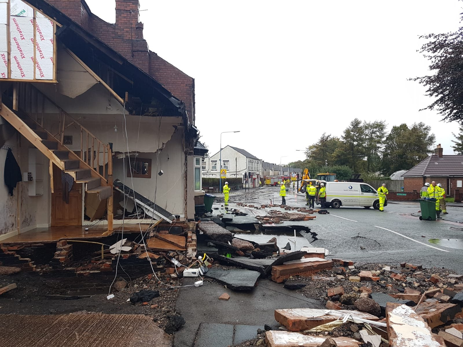 A burst water main has caused damage in Birmingham, where a house has partially collapsed (West Midlands Fire Service/PA)