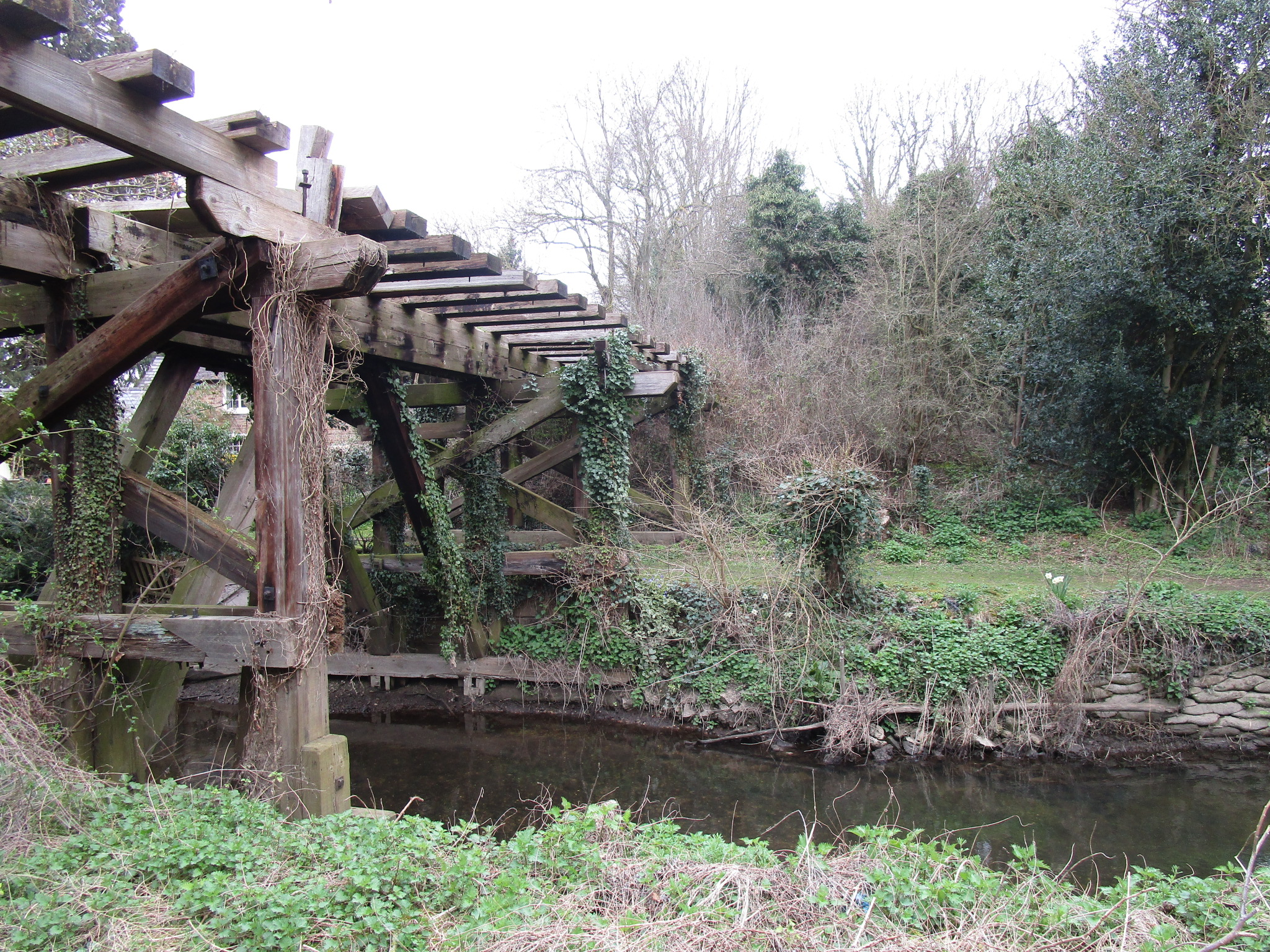 The last surviving timber trestle railway bridge in England has been added to the at risk list (Historic England/PA)
