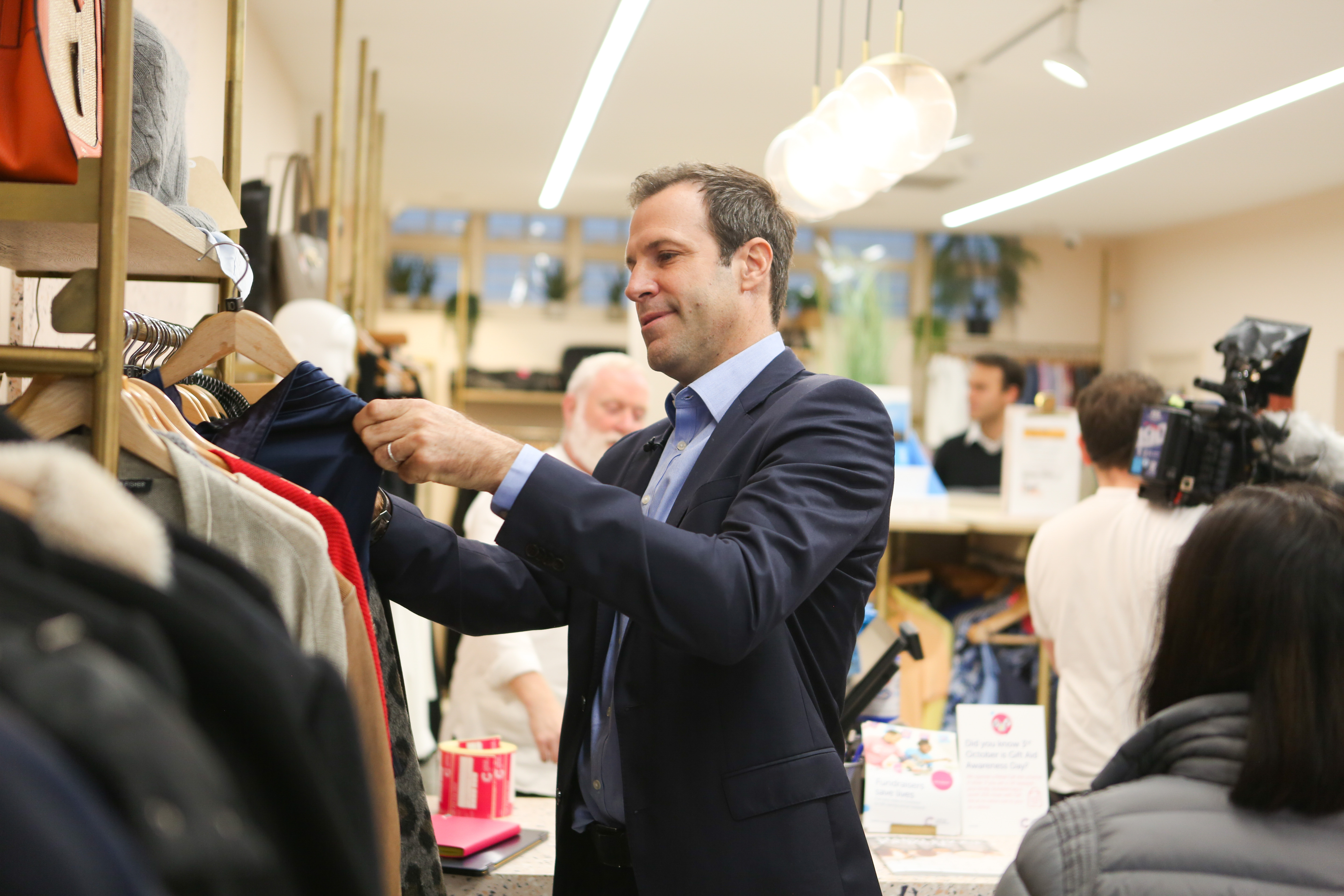 Greg Rusedski helped out at a Cancer Research UK shop to launch the charity's partnership with the Nitto ATP Finals