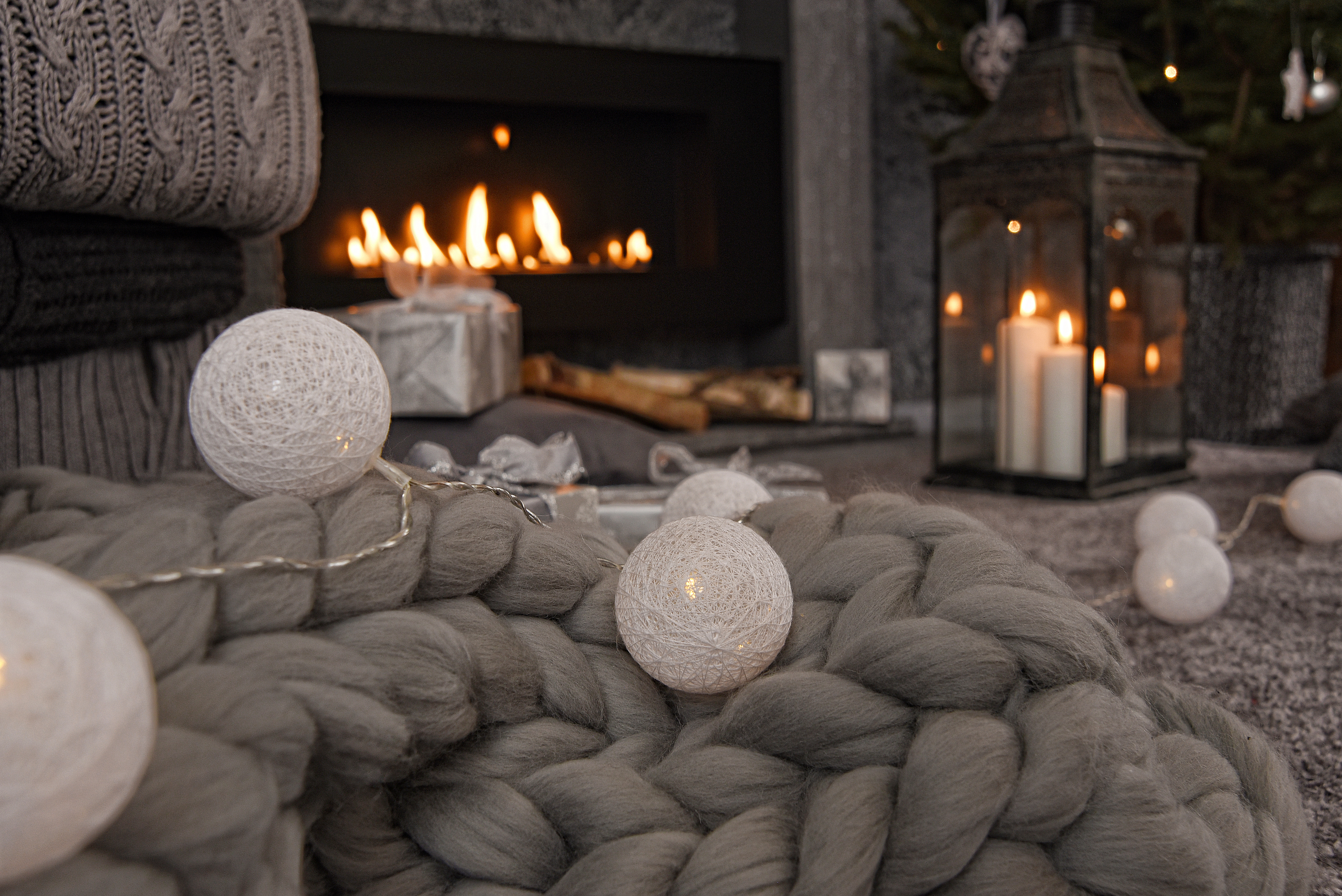 A chunky wool throw, a string of lights and a selection of lanterns are key ingredients for a room with a glow (iStock/PA)