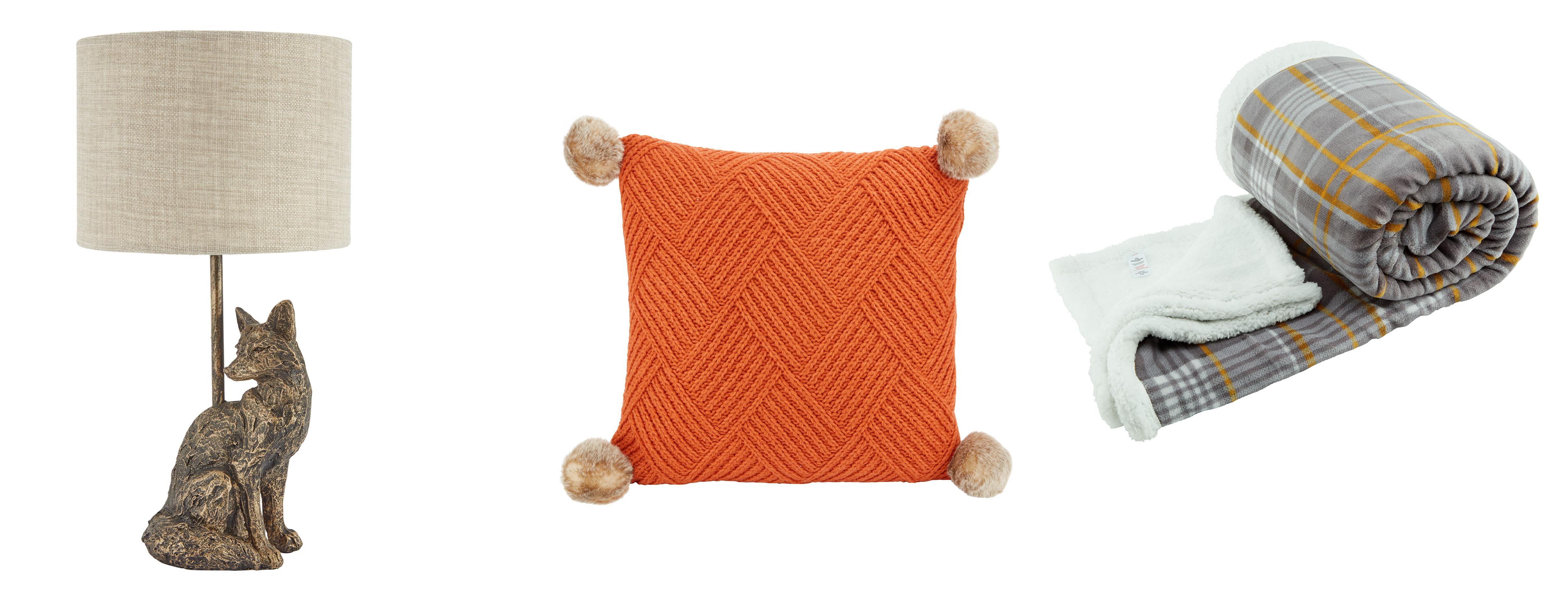 (L-R) Morrisons Ochre Birdy Fox Table Lamp, £17; Morrisons Century Studio Orange Knit Cushion, !2; Morrisons Ochre Birdy Country Check Throw, £18 (Morrisons/PA)