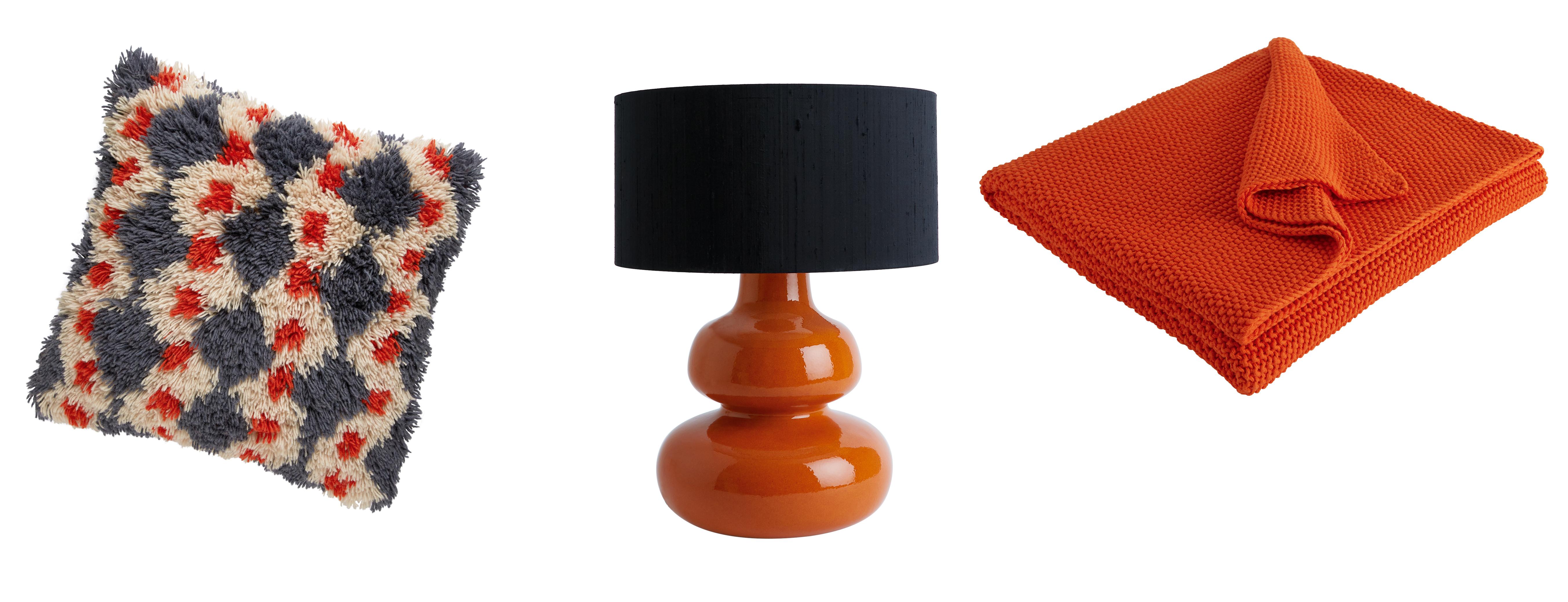 (L-R) Casper Charcoal & Orange Geometric Shaggy Pile Cushion, currently reduced to £35 from £70; Lantana Orange Curvy Lamp With Black Drum Silk Shade, £115, Habitat (Habitat/PA)