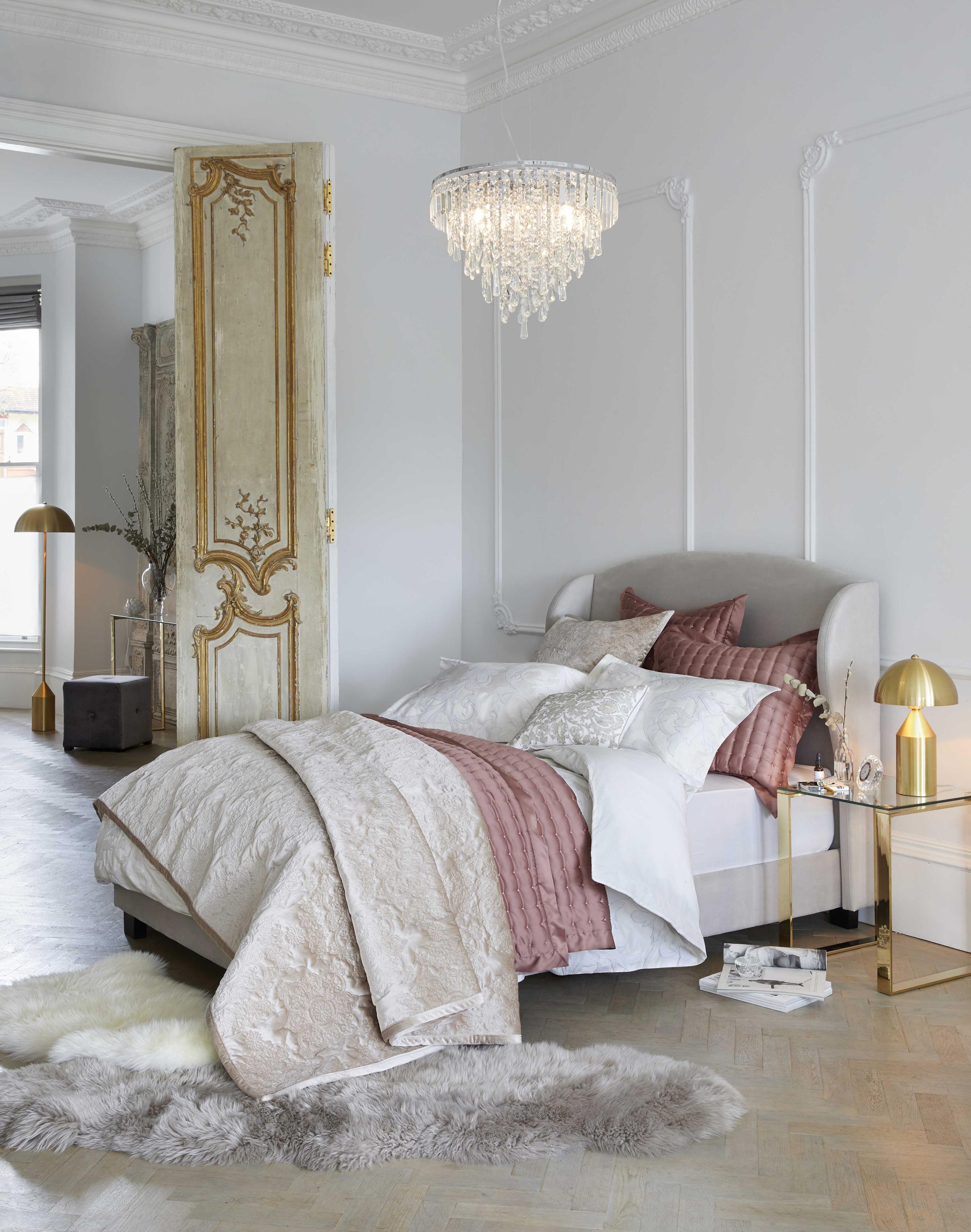 Blenheim Upholstered Bed Frame, £399-£439; Monroe Crystal Fitting Chrome, £219; Dorma Acanthus Jacquard Duvet Cover, £70-£100 & Bedspread,, £150-£170; Dorma Ophelia Ginger Bedspread, £100-£120 & Continental Square Pillowcase, £20; Dorma Arabesque Cushion, £30, Dunelm (Dunelm/PA)