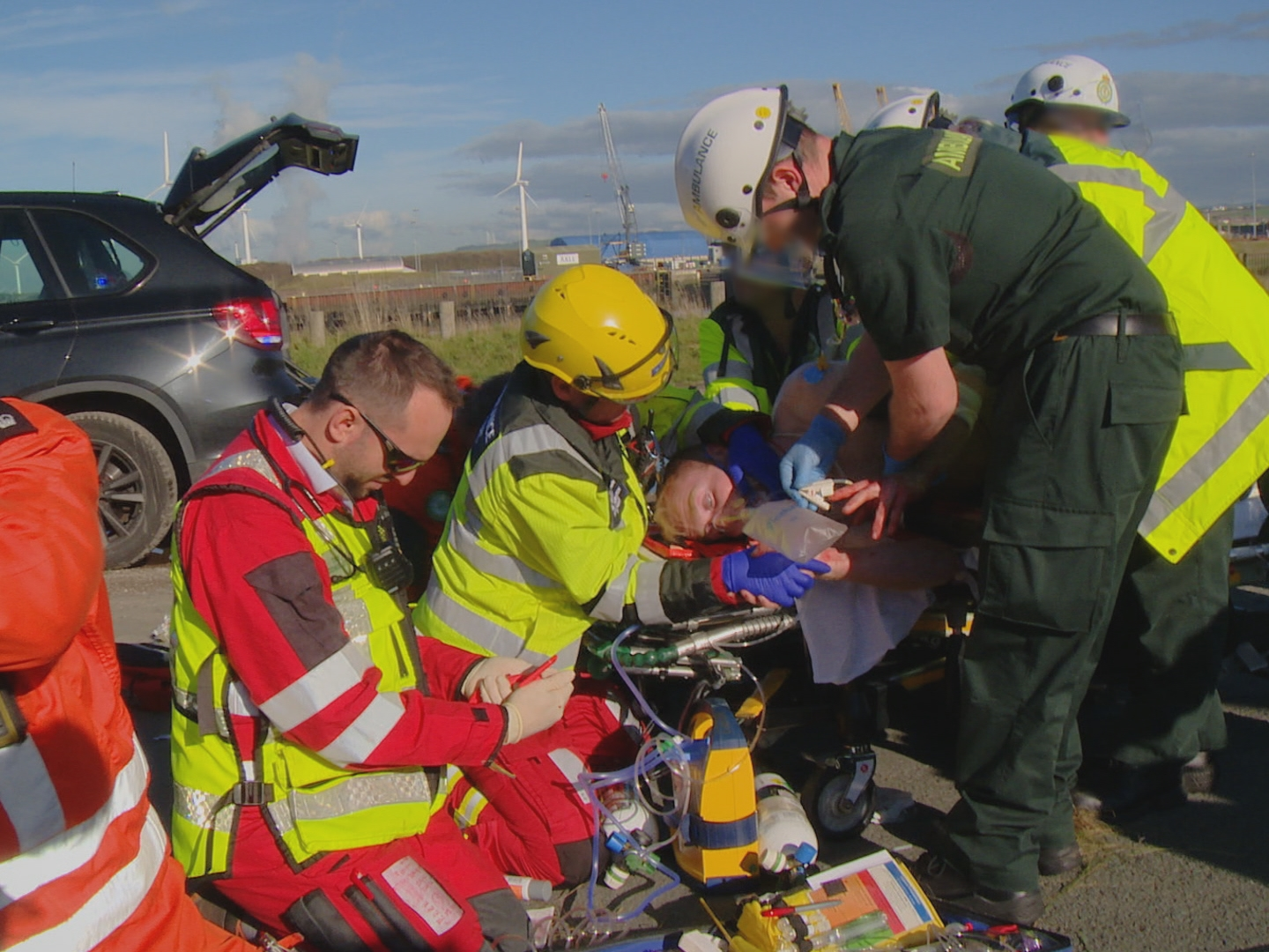 Medics attend to Richard Stephenson at the scene
