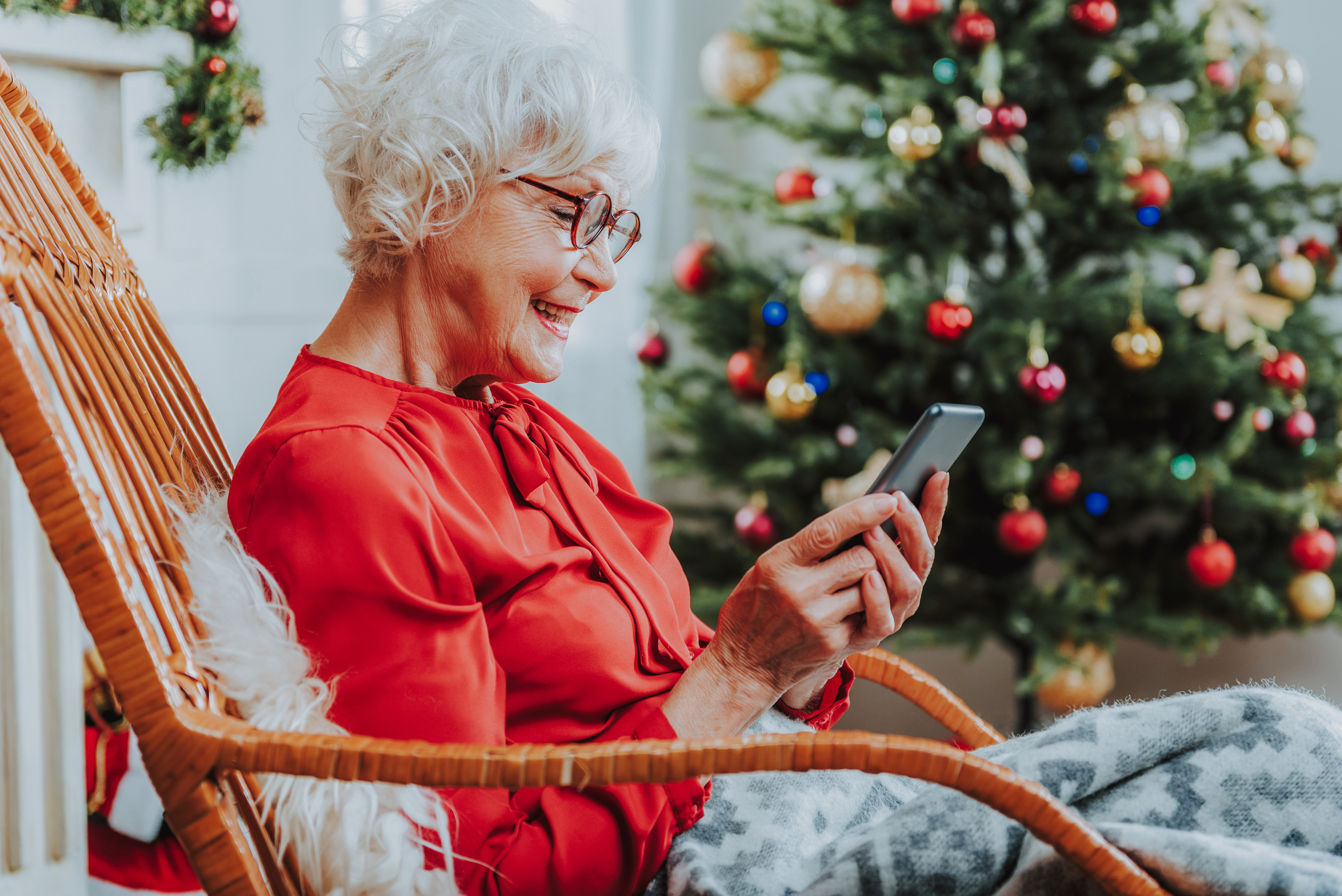 Senior woman reading messages on the phone stock photo