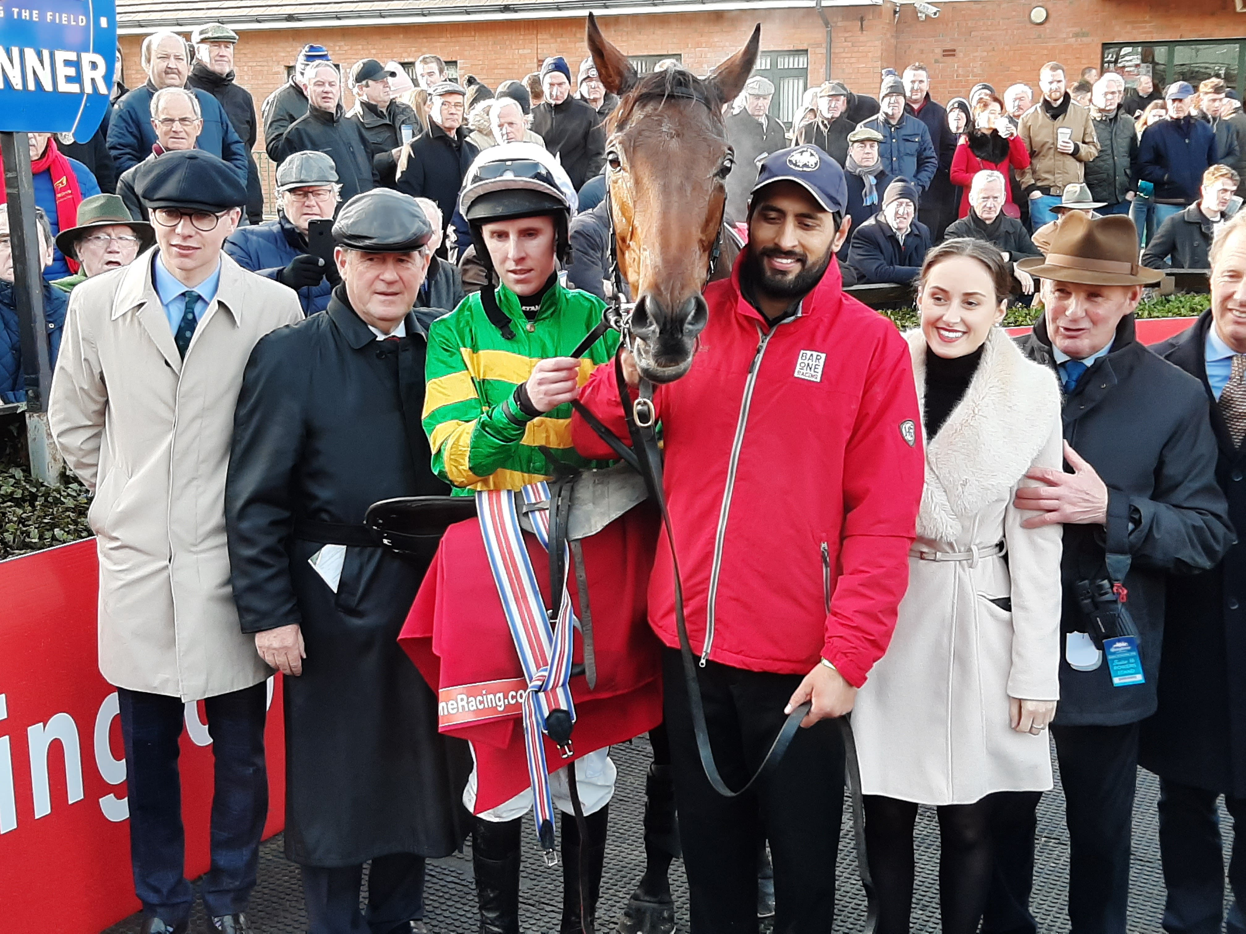 Fakir D'oudairies with connections after his wide-margin win in the Drinmore Novice Chase (PA)