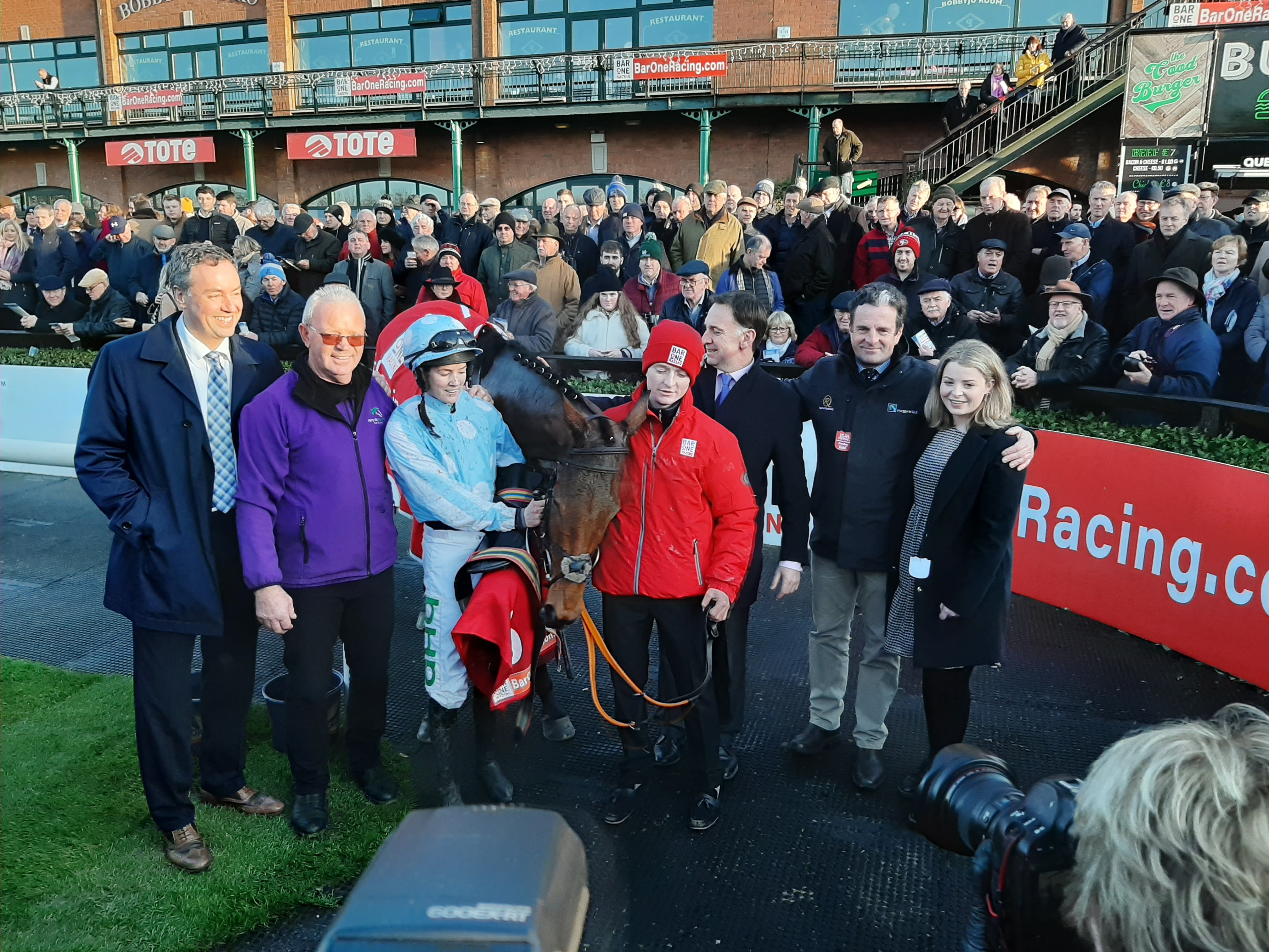 Honeysuckle in the winner's enclosure after her Hatton's Grace Hurdle success (PA)