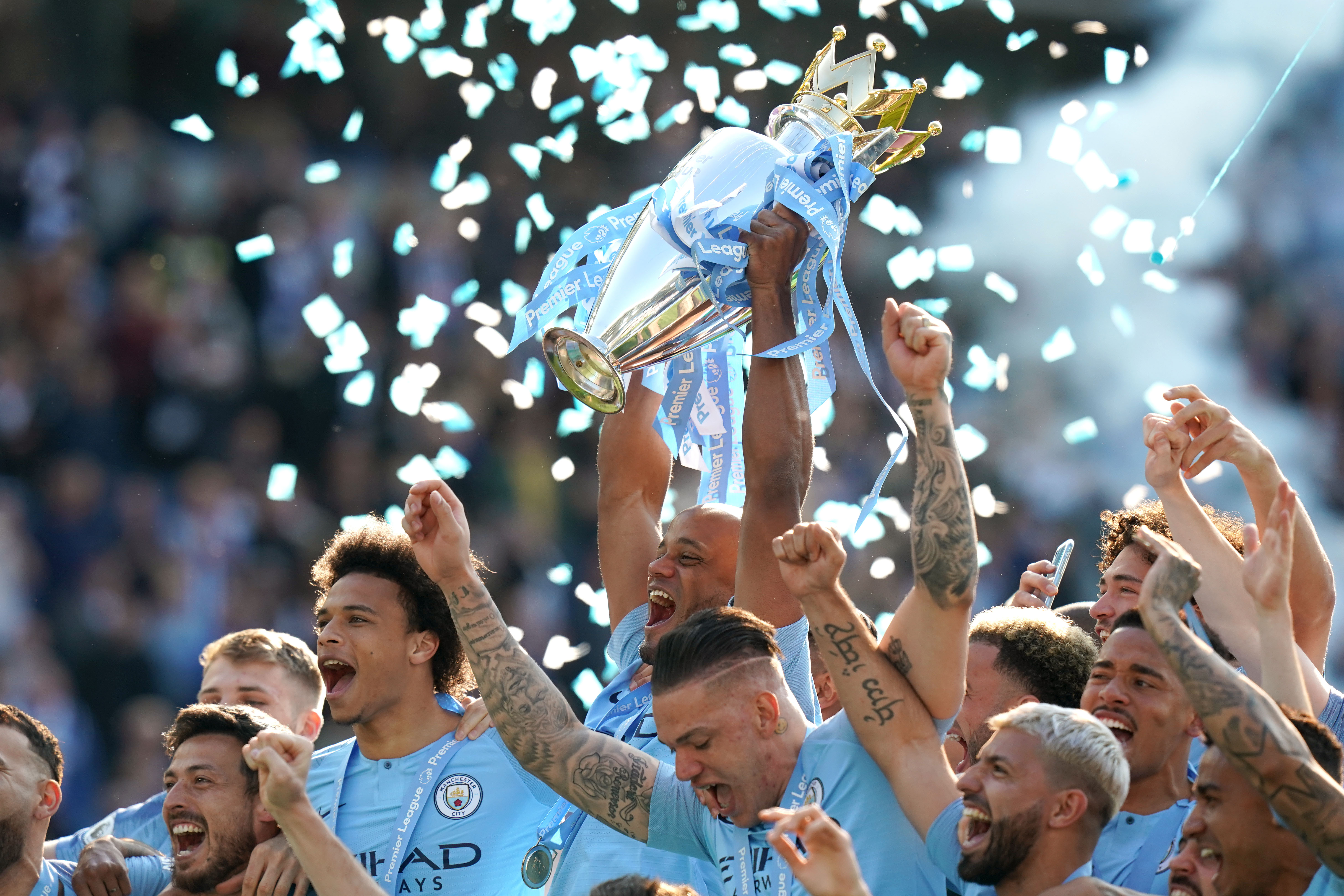 Manchester City captain Vincent Kompany lifts the Premier League trophy at Brighton in May at the end of a thrilling title race. Pep Guardiola's side retained their crown after coming from a goal down to win 4-1 at the Amex Stadium and finish a single point ahead of rivals Liverpool