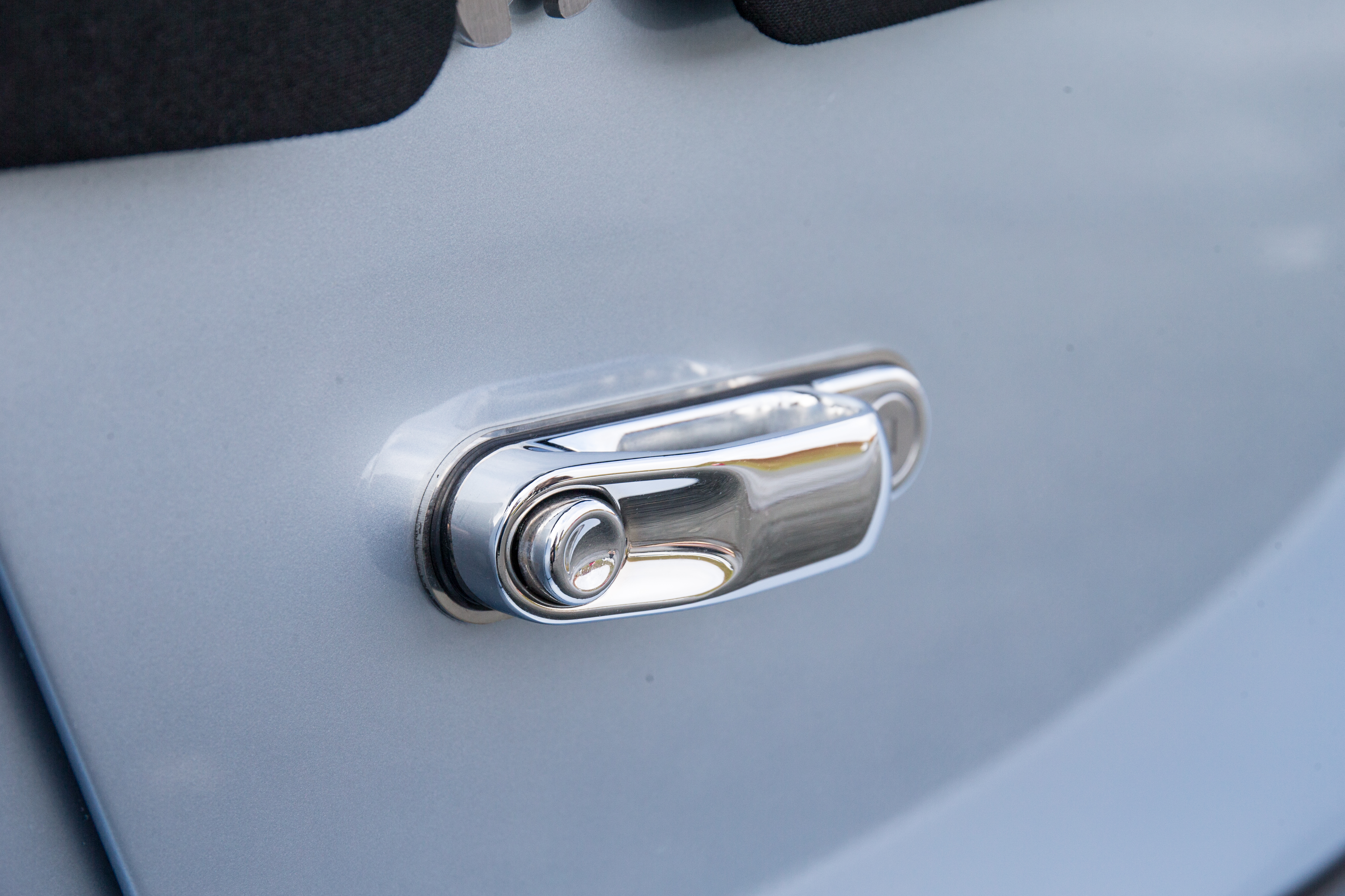 Push button door handles are a classic touch