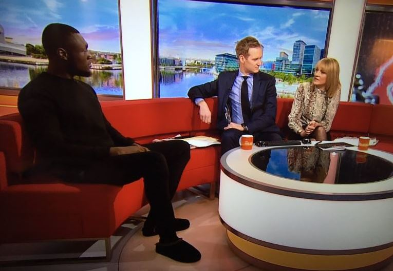 A grab of Stormzy on BBC Breakfast wearing his slippers